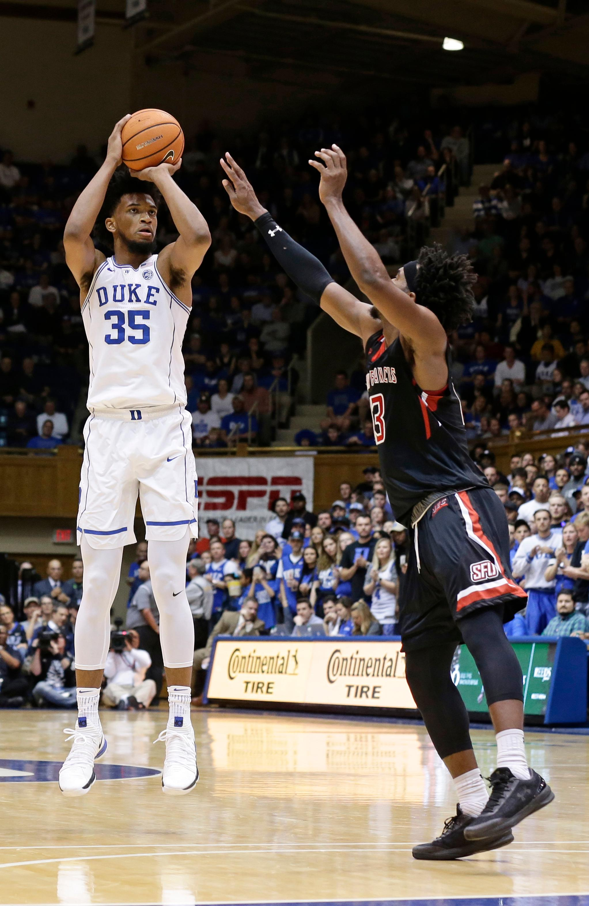 File- This Dec. 5, 2017, file photo shows Duke's Marvin Bagley III (35) shooting while Saint Francis' Keith Braxton (13) defends during the first half of an NCAA college basketball game in Durham, N.C. Duke coach Mike Krzyzewski isn't interested in thinking about how his latest group compares to his past teams. Regardless, this year's team, led by senior Grayson Allen and top-tier freshman Bagley, sure looks like a squad set to win another Atlantic Coast Conference championship for its Hall of Fame coach as the bulk of league play arrives this weekend.  (AP Photo/Gerry Broome, File)