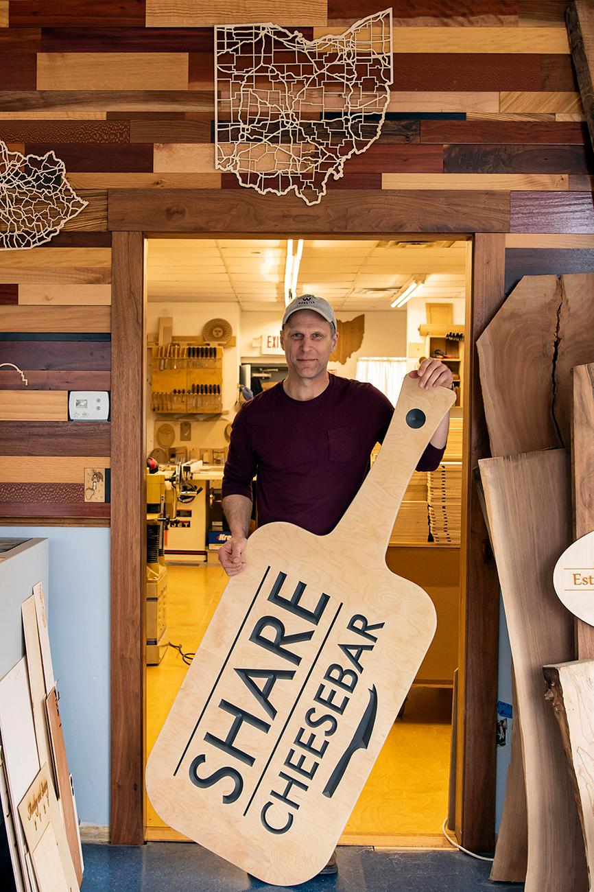 Thane Lorbach has been a professional woodworker for over 16 years in the Pleasant Ridge area. He creates small wooden decor, plaques, and local beer taps, as well as larger projects like bar tops, custom furniture, signs, and display cases. Thane uses a mix of both traditional and modern techniques when crafting his art for residential and commercial clients in his shop, Thane Lorbach Custom Woodworking, in Pleasant Ridge. ADDRESS: 5935 Ridge Road (45213) / Image: Allison McAdams // Published: 3.1.20