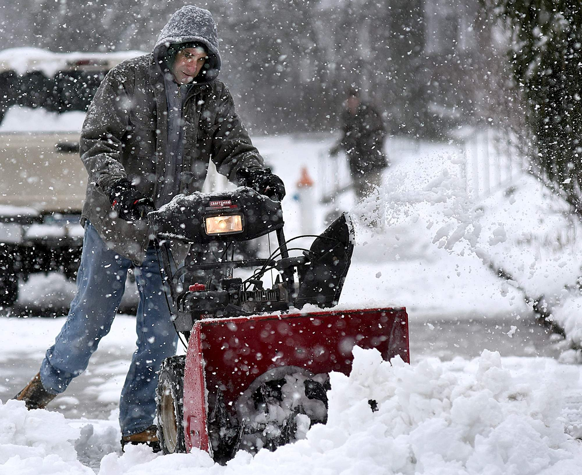Josh Heron clears the sidewalk in front of his neighbor's place with a snowblower in Perkasie during the second snow storm to hit the area in the past week. on Wednesday, March 7, 2018. [ART GENTILE / STAFF PHOTOJOURNALIST]