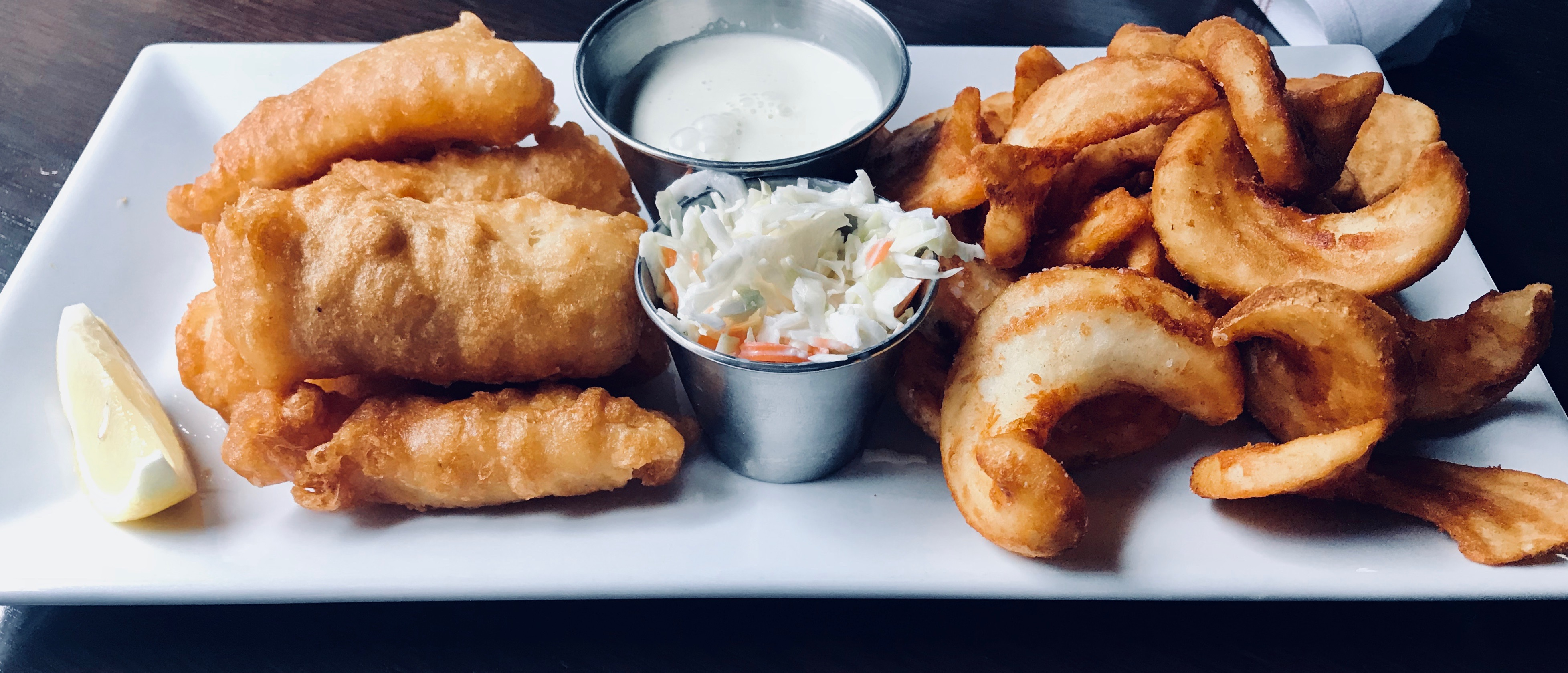 Bar Deco offers a fish and chips special every Friday (all year round!) for $12. You also can't go wrong with crispy fish tacos, served with beer-battered cod, slaw, pico de gallo and tartar sauce ($17). (Image: Courtesy Bar Deco)<p></p>