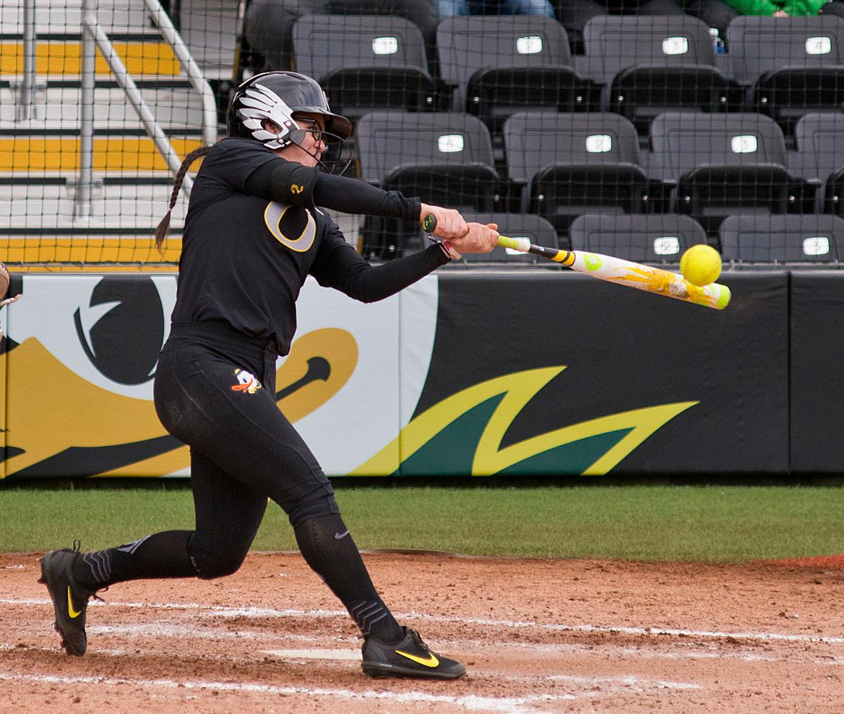 Oregon Ducks Danica Mercado (#2) gets a solid hit against the California Golden Bears. The Ducks defeated the Golden Bears 2-1 in the second game of a three-game series. Photo by Dan Morrison, Oregon News Lab