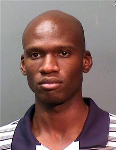 This booking photo provided by the Fort Worth Police Department shows Aaron Alexis, arrested in September, 2010, on suspicion of discharging a firearm in the city limits.