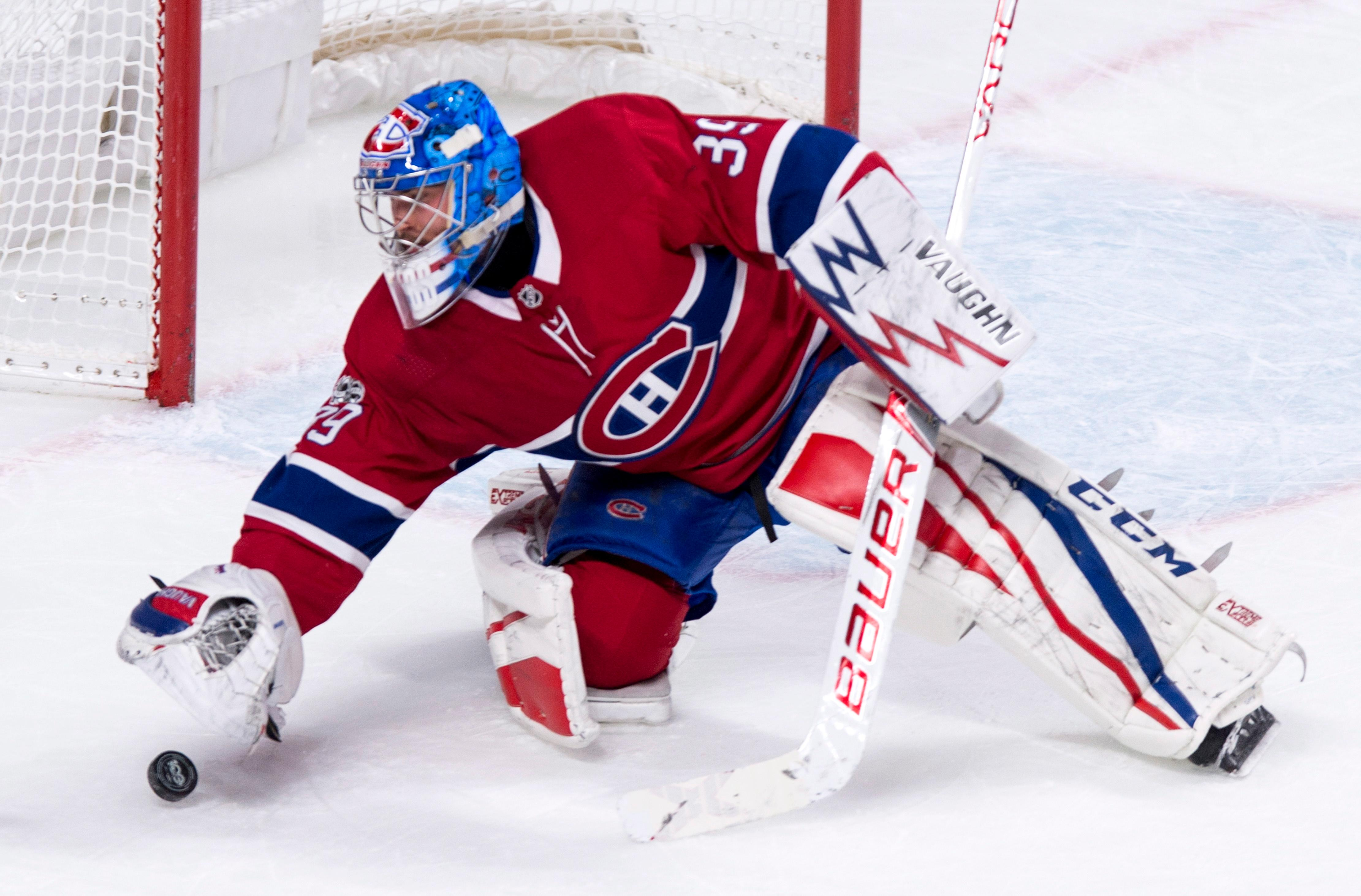 Montreal Canadiens goalie Charlie Lindgren stops a rolling puck during the second period of an NHL hockey game against the Columbus Blue Jackets on Tuesday, Nov. 14, 2017, in Montreal. (Paul Chiasson/The Canadian Press via AP)