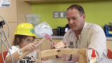 Kids at St. John's Hospital build their own tool boxes
