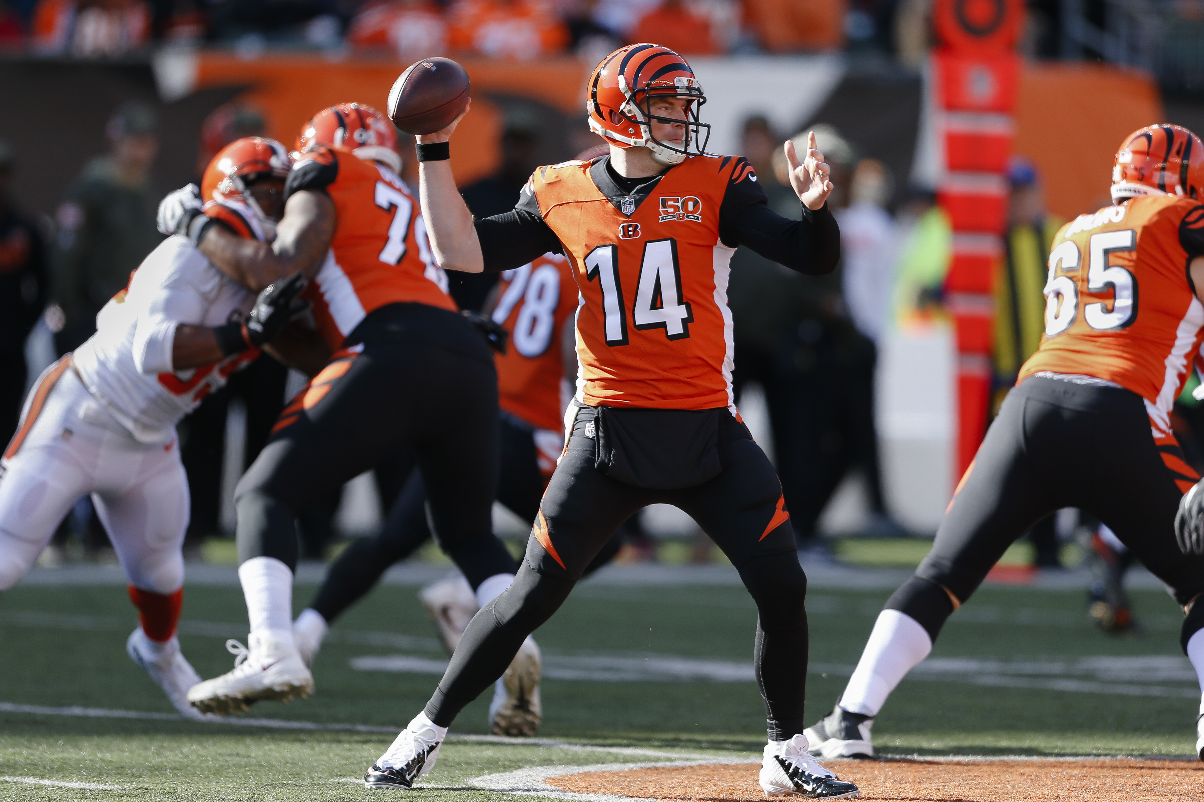 Cincinnati Bengals quarterback Andy Dalton passes in the first half of an NFL football game against the Cleveland Browns, Sunday, Nov. 26, 2017, in Cincinnati. (AP Photo/Gary Landers)