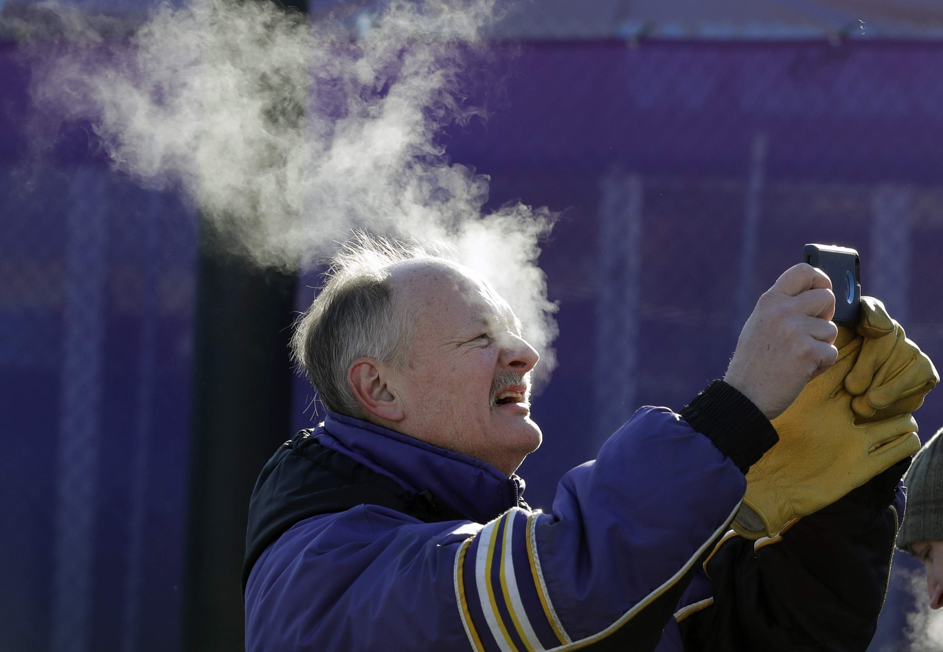 A fan braves cold temperatures as he takes a selfie outside U.S. Bank Stadium for the NFL Super Bowl 52 football game between the Philadelphia Eagles and the New England Patriots Sunday, Feb. 4, 2018, in Minneapolis. (AP Photo/Eric Gay)
