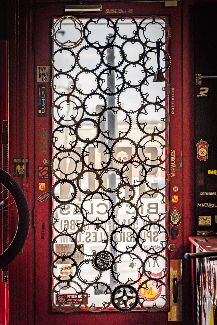 SPUN's front door is iconic. It is outfitted with a web of bicycle gears. / Image: Phil Armstrong, Cincinnati Refined // Published: 3.19.17