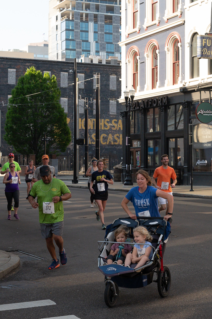 Many runners pushed their babies and young children along the route. / Image: Phil Armstrong // Published: 5.19.19