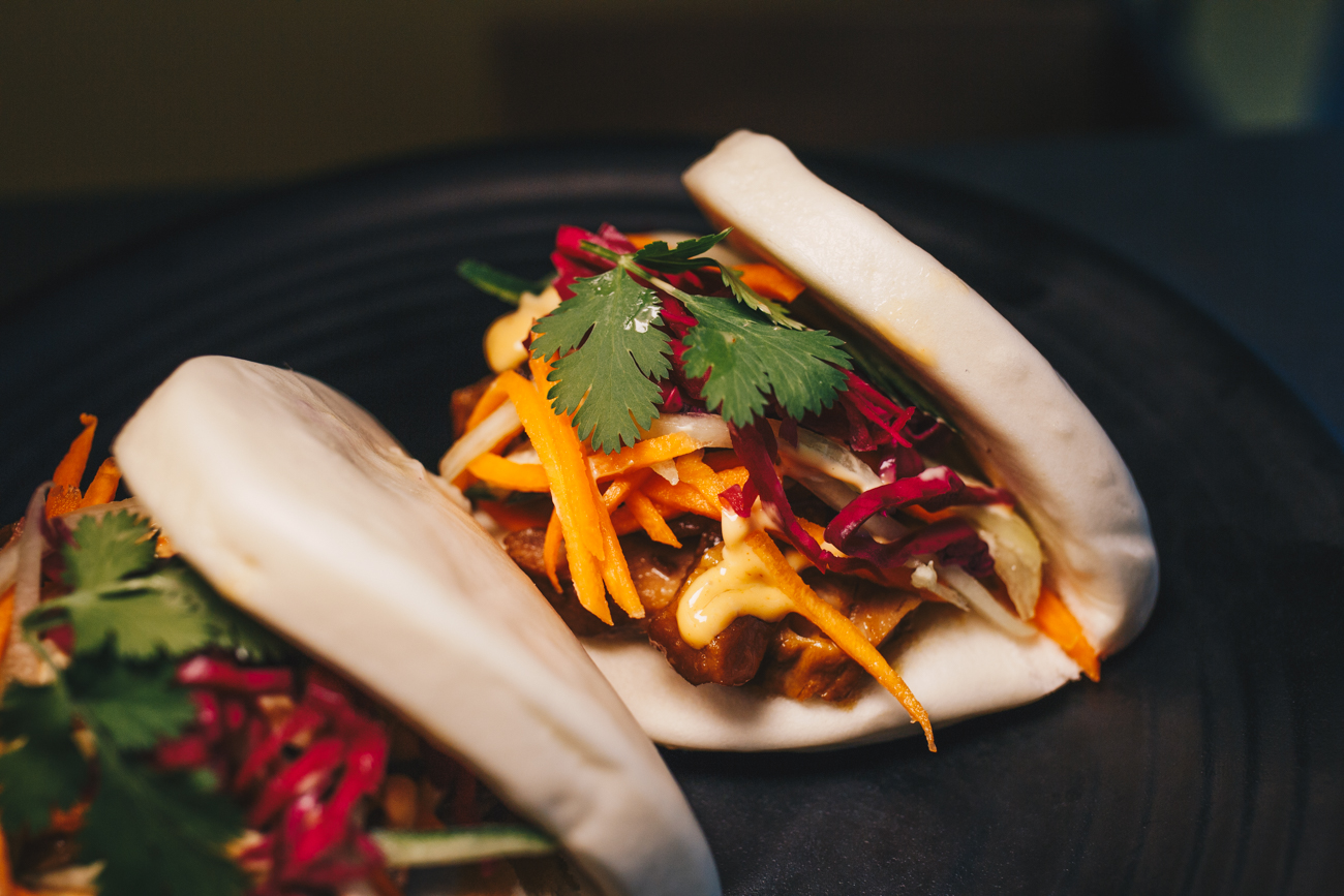 Pork Belly Bao-Wich: steamed white bread sandwich layered with carmelized pork belly, pickled carrots, pickled cabbage, cucumber, and cilantro / Image: Catherine Viox // Published: 4.22.19