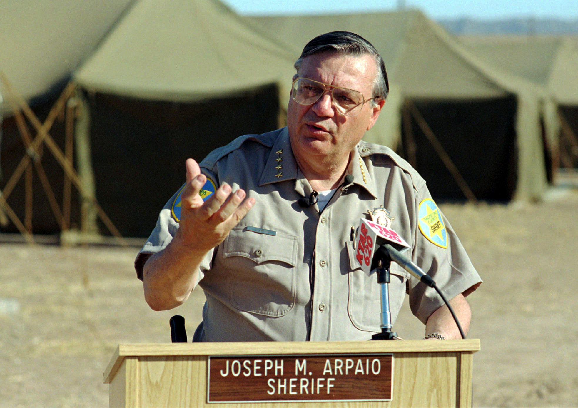 FILE--In this May 9, 1995, file photo, Maricopa County Sheriff Joseph Arpaio talks with media during a news conference announcing the opening of Tent City II in Phoenix, Ariz. Arpaio has been convicted of a criminal charge Monday, July 31, 2017, for disobeying a court order to stop traffic patrols that targeted immigrants in a conviction that marks a final rebuke for the former sheriff and politician who once drew strong popularity from such crackdowns but was booted from office amid voter frustrations over his deepening legal troubles. (AP Photo/T.J. Sokol, file)
