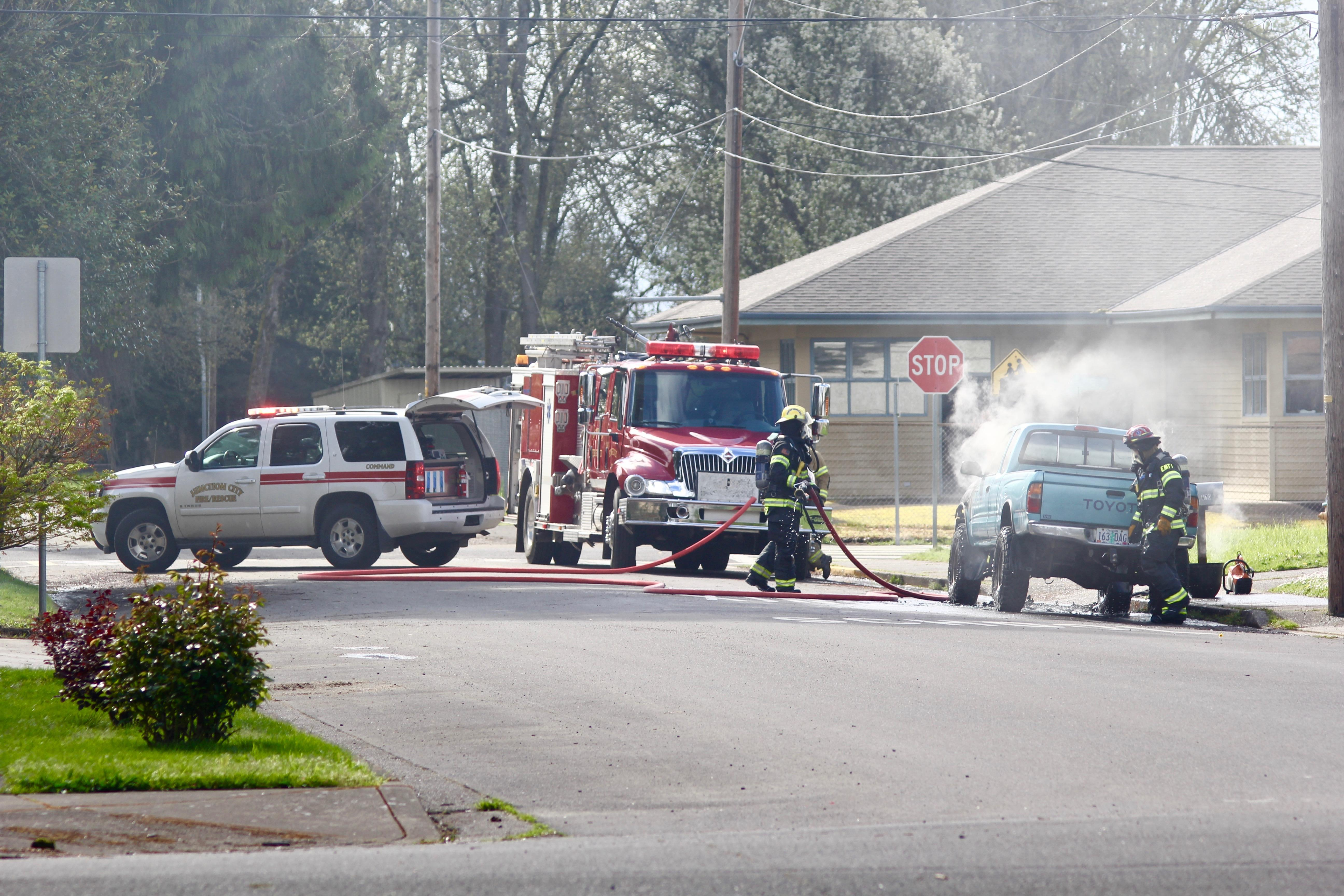 Smoke filled 13th Street on Thursday afternoon as a pickup truck caught fire. No one was injured. (Photo by Caleb Amundson)