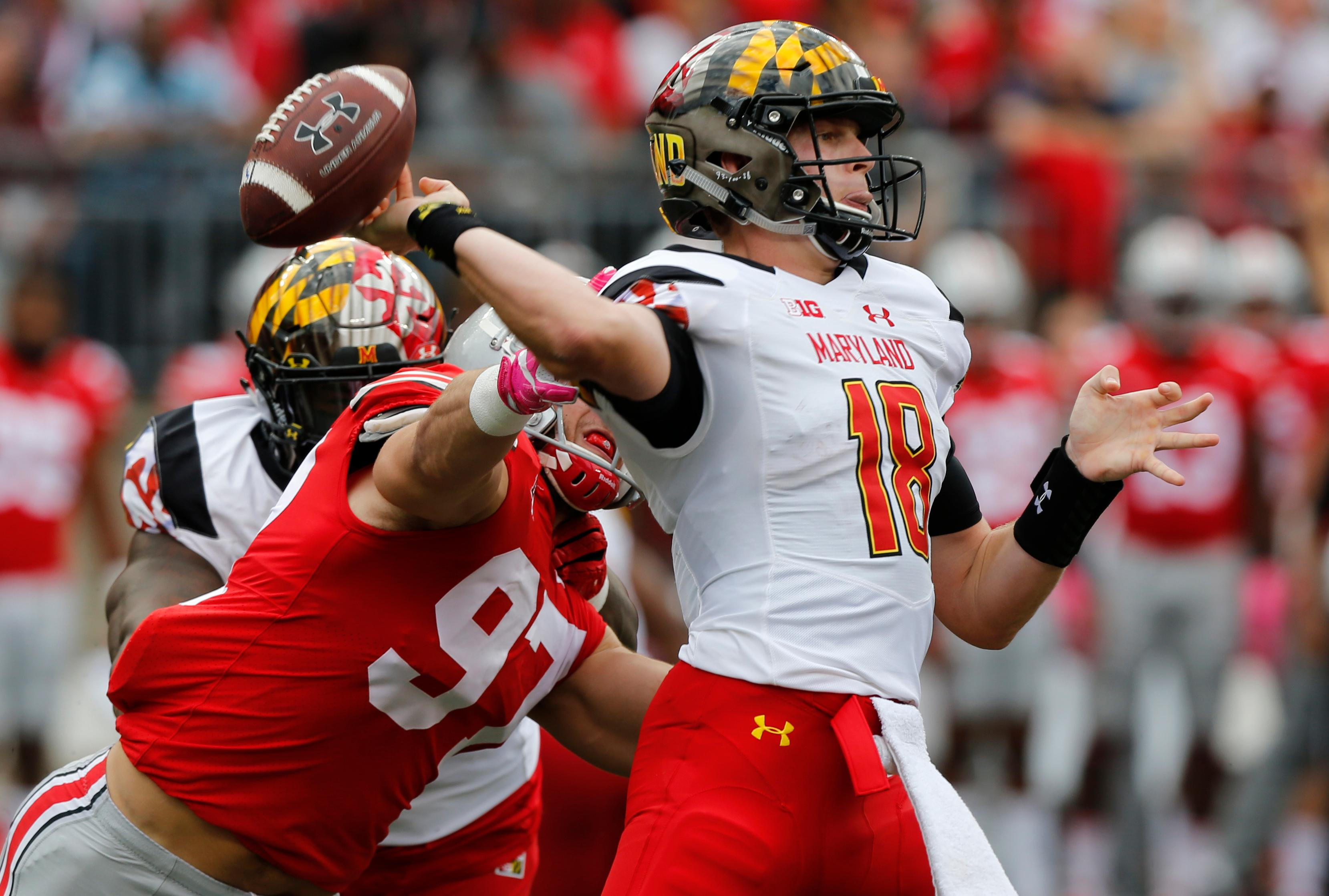 Ohio State defensive end Nick Bosa, left, causes Maryland quarterback Max Bortenschlager to fumble the ball during the first half of an NCAA college football game Saturday, Oct. 7, 2017, in Columbus, Ohio. (AP Photo/Jay LaPrete)