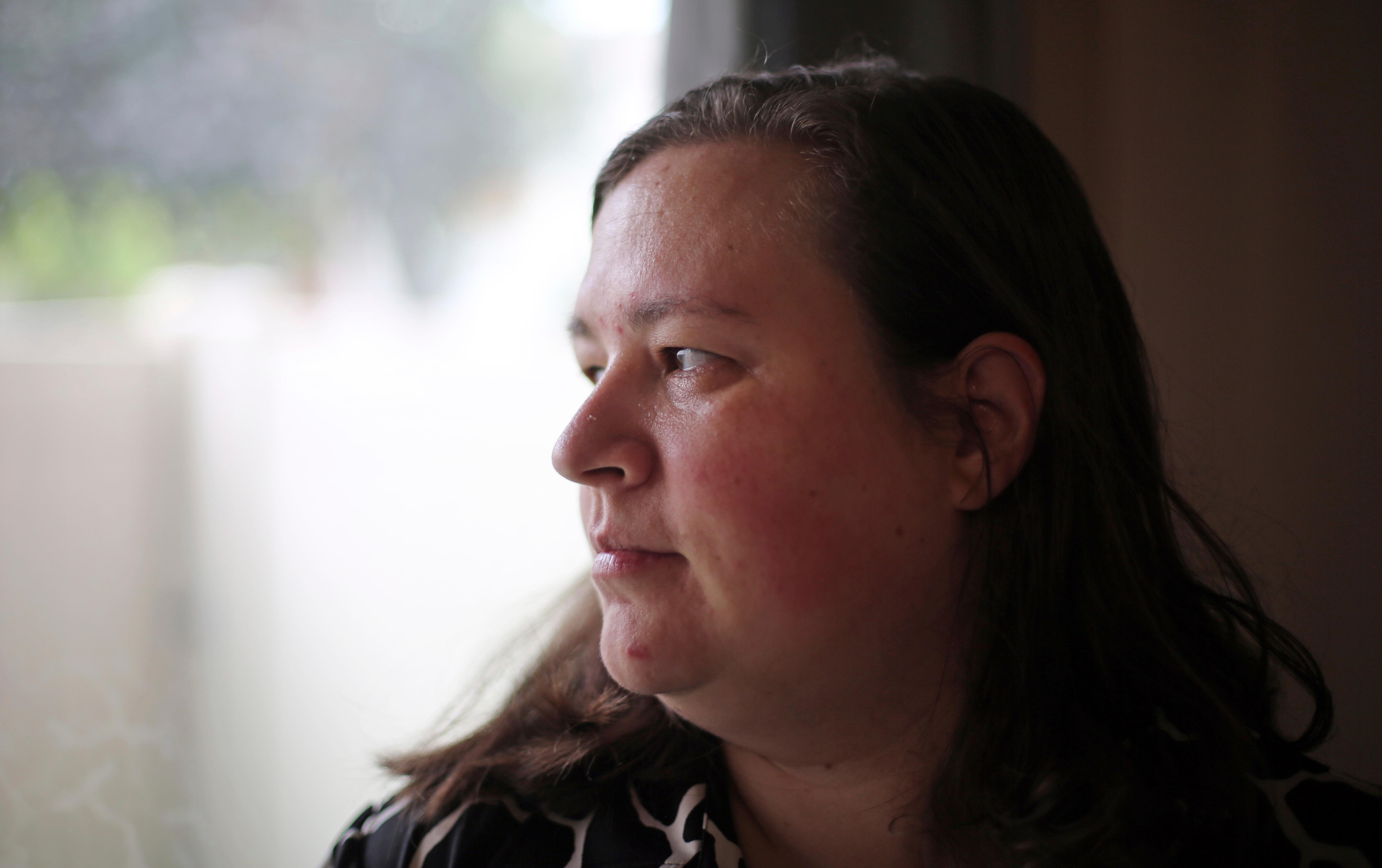 "Heidi Clark looks out of the window of her home in Orem, Utah, on Friday, May 18, 2018. Clark became pregnant at 16 and married soon after, under pressure from her boyfriend's religious community of Seventh-Day Adventists in Pennsylvania, she said. ""I always felt a little bit like I was trapped,"" Clark said, now 40. ""I was 17. I was so young."" Utah state Rep. Angela Romero wants to ban marriage for anyone under 18 as part of a national push to outlaw underage marriage. (AP Photo/Rick Bowmer)"