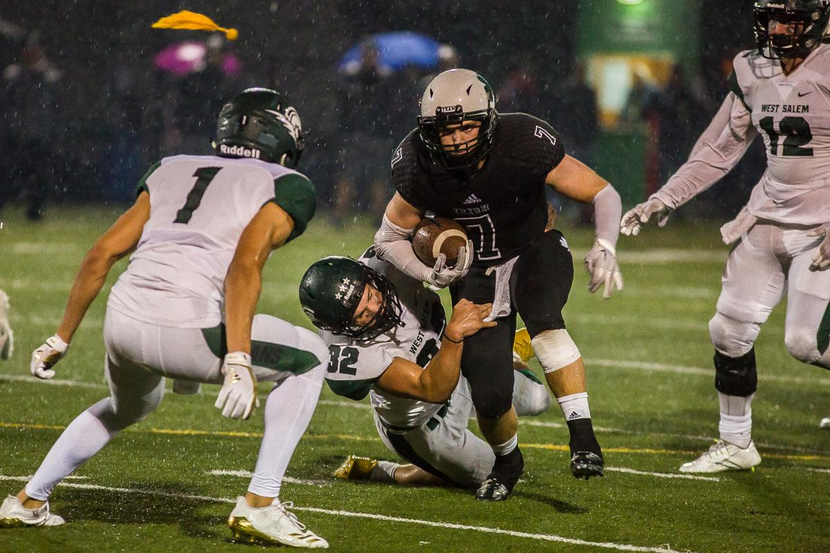 West Salem linebacker Ryan Baxter (#32) attempts to take down Sheldon running back Jaren Banks (#7). On a rainy Monday evening Sheldon defeated West Salem 41-7 at home. The game had been postponed from Friday due to unhealthy levels of smoke in the atmosphere due to nearby forest fires. Photo by Dillon Vibes