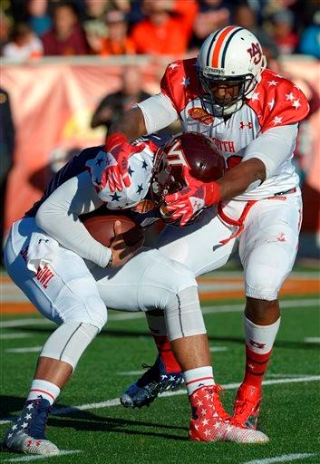 North quarterback Logan Thomas of Virginia Tech (3) is sacked by South defensive end Dee Ford of Auburn (30) during the first quarter of the Senior Bowl NCAA college football game on Saturday, Jan. 25, 2014, in Mobile, Ala.