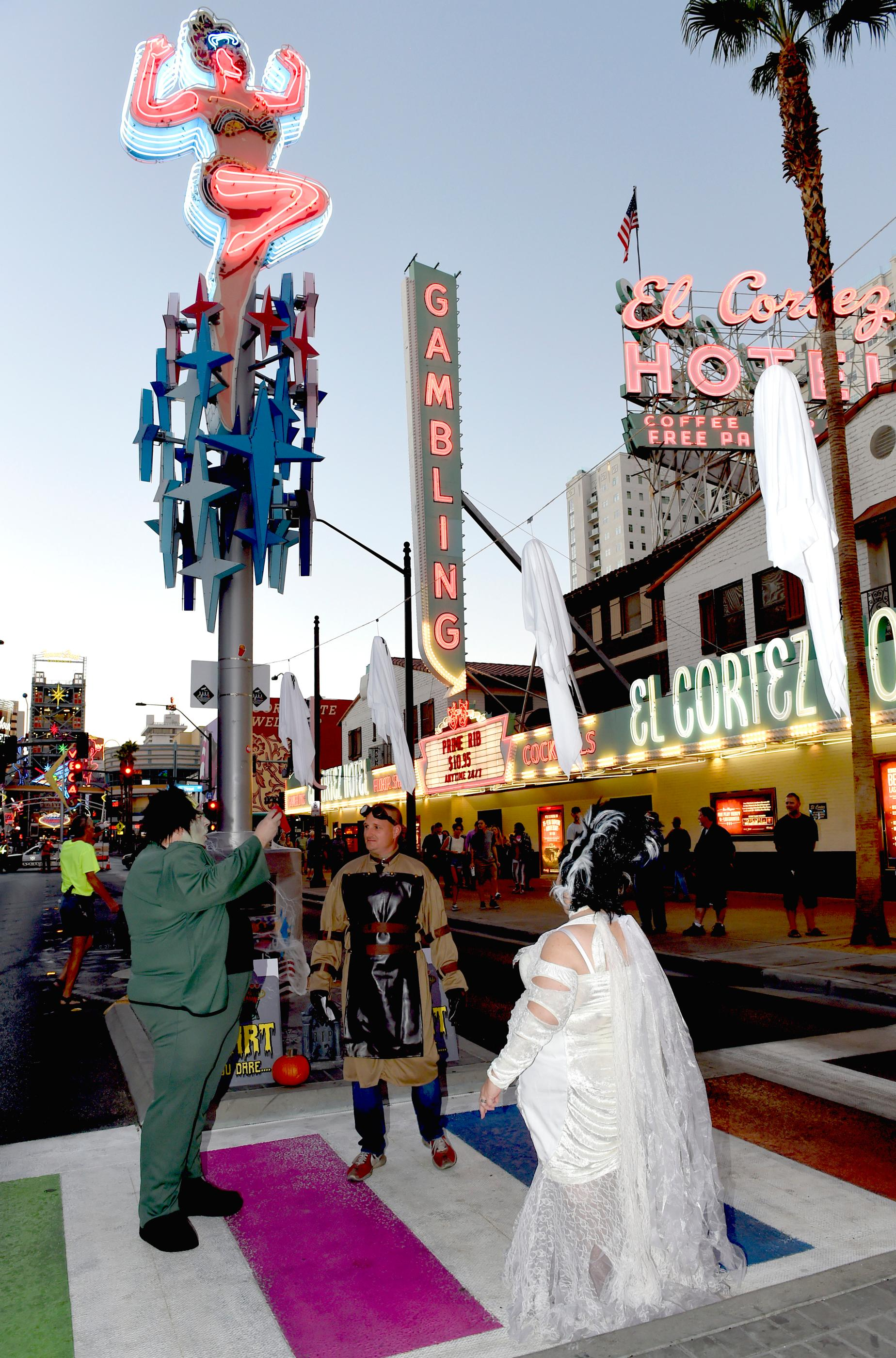 Dr. Frankenstein presides over the renewal of vows by his monster and the Bride of Frankenstein during Sin City Halloween on East Fremont. Saturday, October 28, 2017. [Glenn Pinkerton/Las Vegas News Bureau]