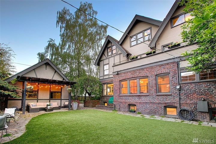 "Beautiful brickwork and arches are the first things that greet you at this historic, pre-war home on Capitol Hill. It has five bedrooms, six bathrooms and is 5,820 square feet to boot! Built in 1912, this home features wide hallways, bright rooms, original leaded glass, wood floors, paneling and wood-burning fireplaces. It's currently listed for $3.45 million by{&nbsp;}<a  href=""https://www.windermere.com/listing/WA/Seattle/1114-21st-Ave-E-98112/109759046"" target=""_blank"">Windermere's Deirdre Doyle</a>. (Image: Greg White /{&nbsp;}<a  href=""https://www.seattlehomephotography.com/"" target=""_blank"">Seattle Home Photography){&nbsp;}</a>"