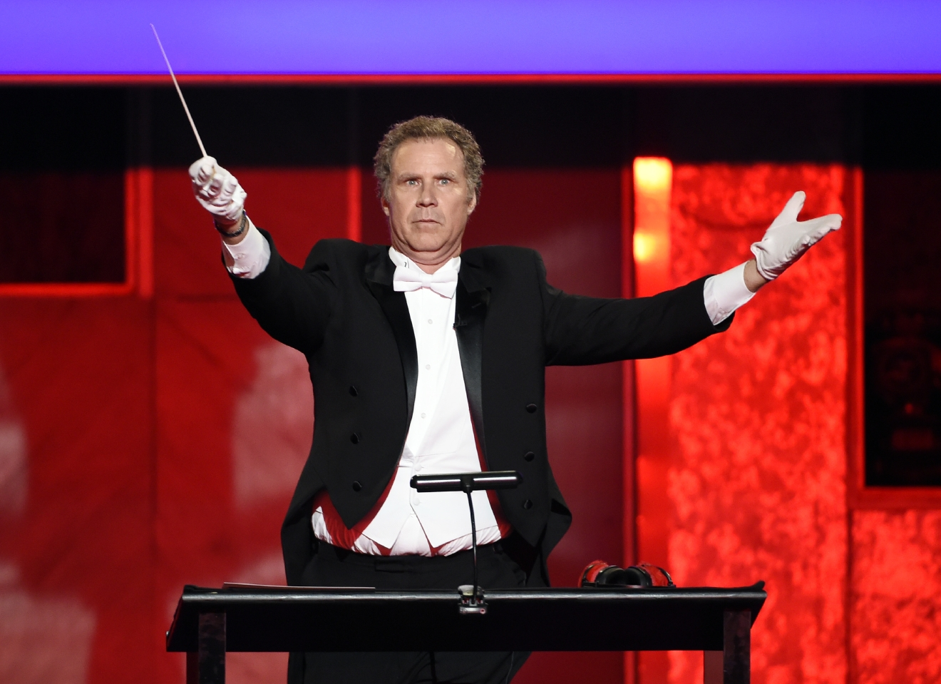Actor Will Ferrell plays a conductor onstage during the 2016 AFI Life Achievement Award Gala Tribute to John Williams at the Dolby Theatre on Thursday, June 9, 2016, in Los Angeles. (Photo by Chris Pizzello/Invision/AP)