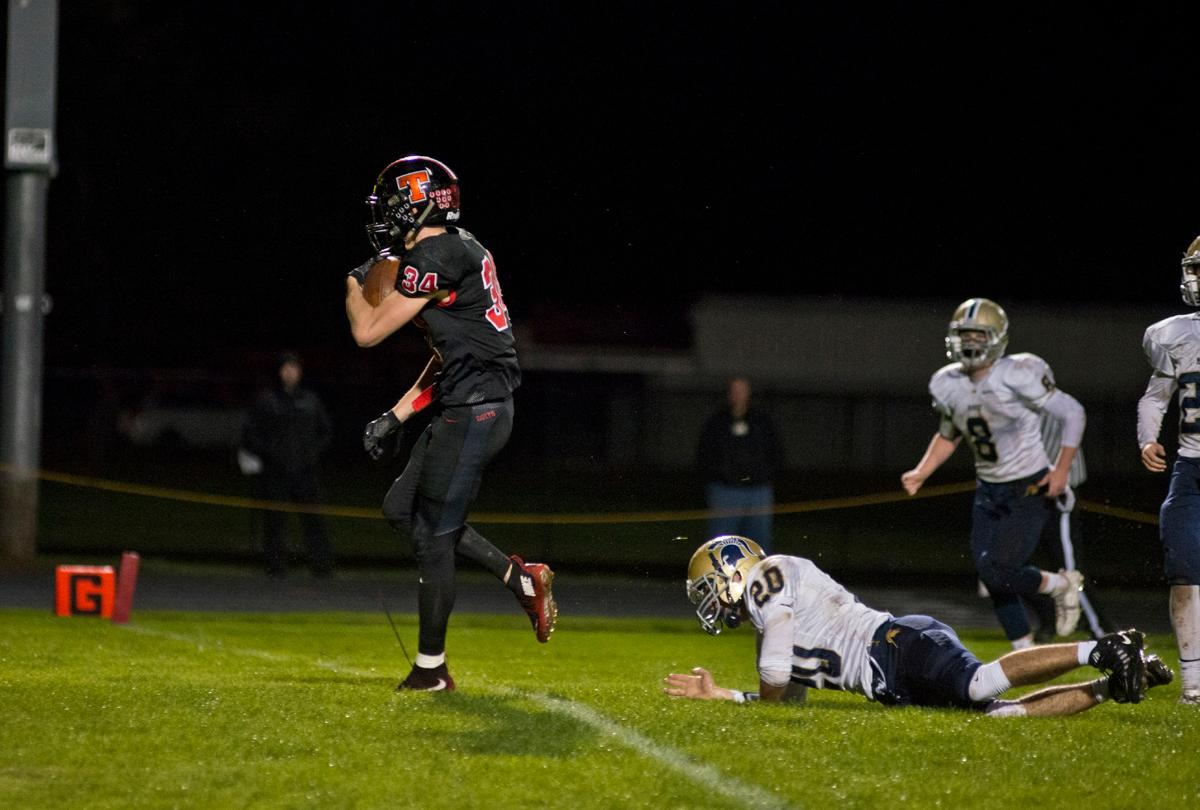 Thurston Colts wide receiver Tyson Haas (#34) spints into the end zone for a score against the Marist Spartans. Thurston defeated Marist 50 to 14 to seal the second position in their conference. Photo by Dan Morrison, Oregon News Lab