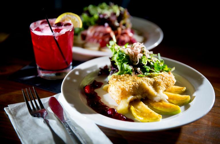 The Starvation Alley cranberry and maple sstuffed brie, consisting of caramelized apples, greens, honey lemon vinaigrette, and cranberry chutney, at the Salt Hotel and Pub, located at 147 Howerton Ave, Ilwaco, WA. (Sy Bean / Seattle Refined)