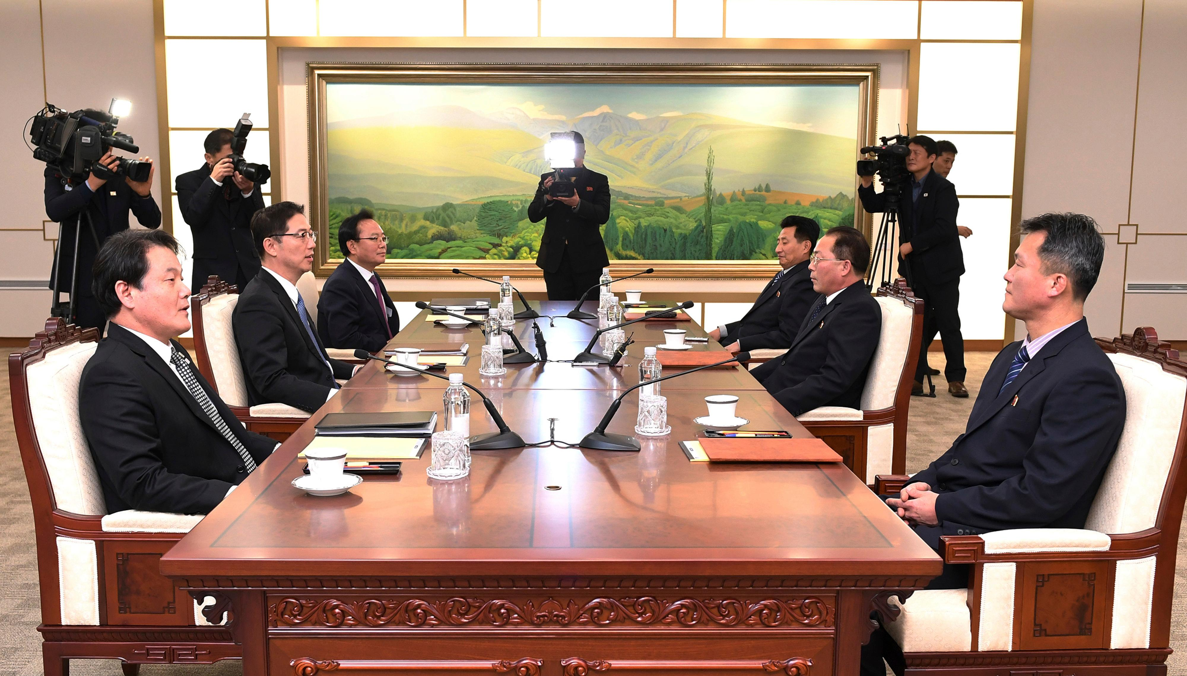 In this photo provided by South Korea Unification Ministry, South Korean Vice Unification Minister Chun Hae-sung, center left, talks with the head of North Korean delegation Jon Jong Su during their meeting at Panmunjom in the Demilitarized Zone in Paju, South Korea, Wednesday, Jan. 17, 2018. The two Koreas are meeting Wednesday for the third time in about 10 days to continue their discussions on Olympics cooperation, days ahead of talks with the IOC on North Korean participation in the upcoming Winter Games in the South. (South Korea Unification Ministry via AP)