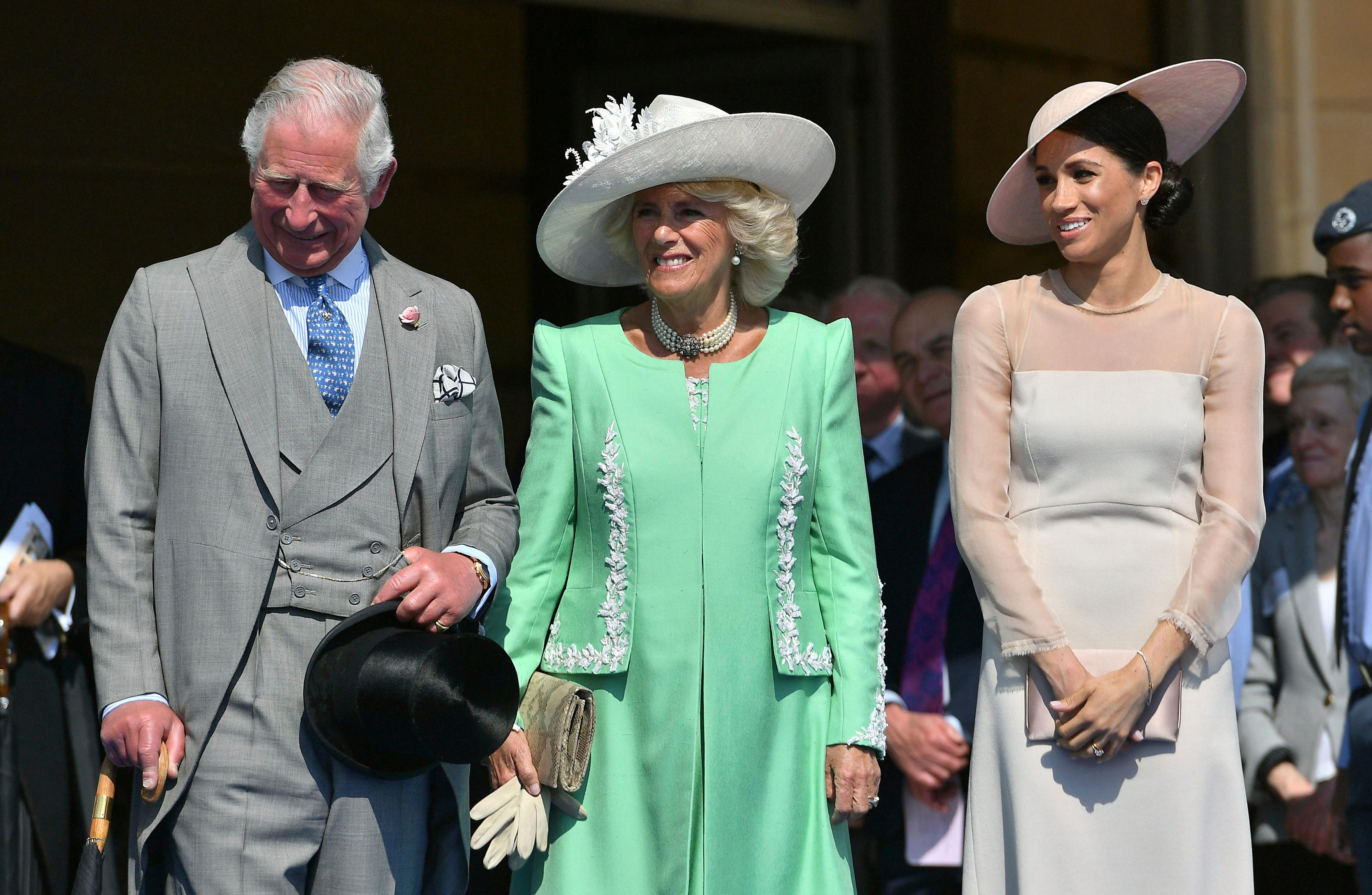 From left, Britain's Prince Charles, Camilla, the Duchess of Cornwall, and Meghan, the Duchess of Sussex attend a garden party at Buckingham Palace in London, Tuesday May 22, 2018. The event is part of the celebrations to mark the 70th birthday of Prince Charles.  (Dominic Lipinski/Pool Photo via AP)