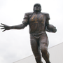 Some say sexual assault accusations against Jim Brown warrant taking down statue at SU