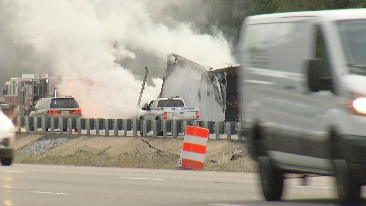 A tractor-trailer catches fire on Interstate 95 north in Attleboro, early Friday, June 16, 2017. (WJAR)