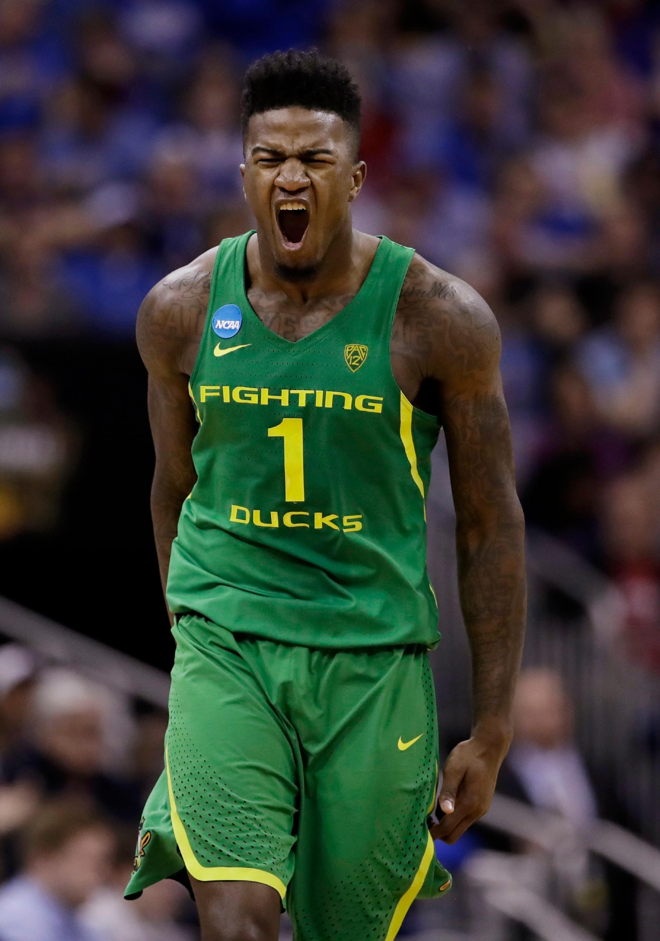 Oregon forward Jordan Bell celebrates during the first half of the team's Midwest Regional final against Kansas in the NCAA men's college basketball tournament, Saturday, March 25, 2017, in Kansas City, Mo. (AP Photo/Charlie Riedel)