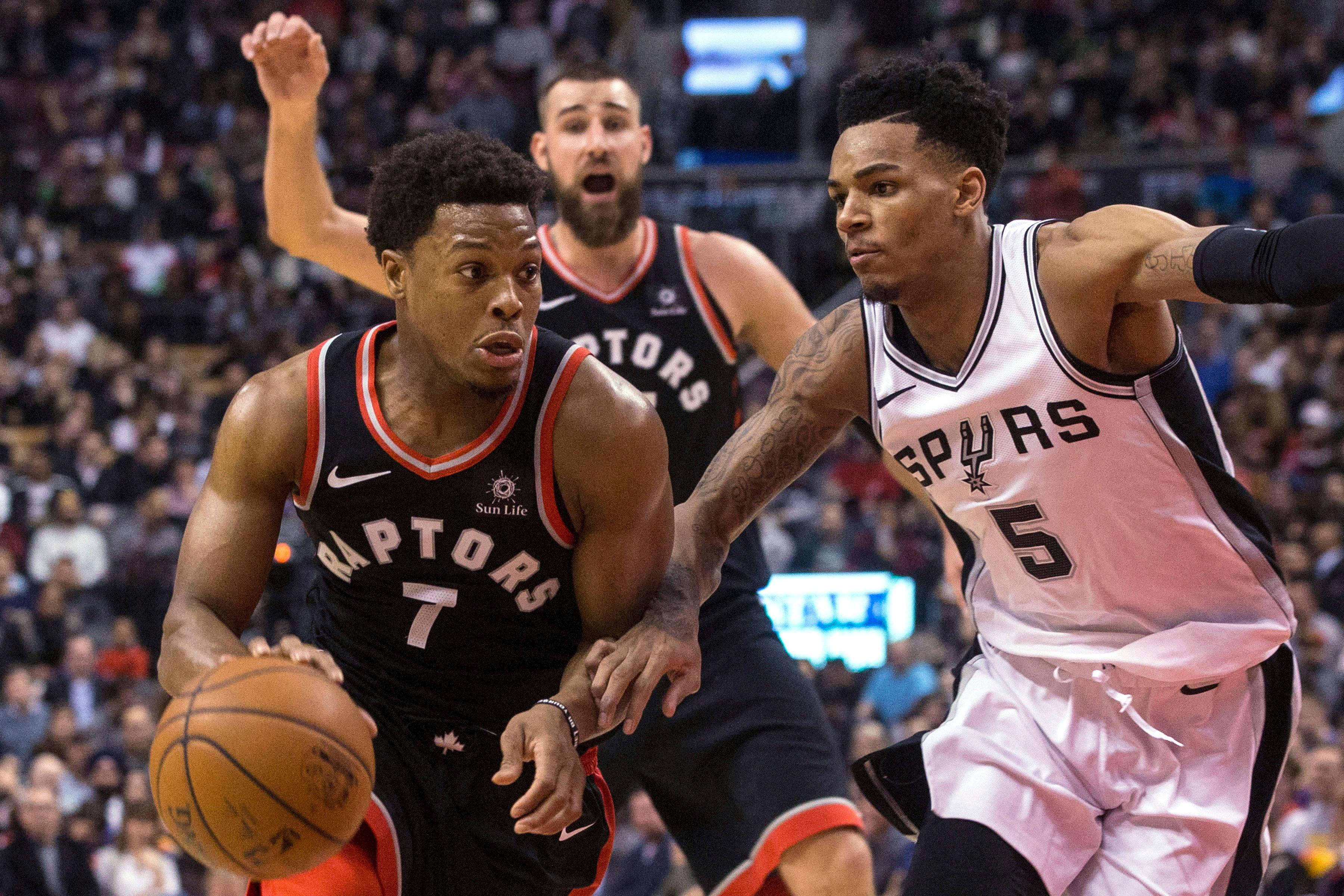 Toronto Raptors guard Kyle Lowry (7) drives on San Antonio Spurs guard Dejounte Murray (5) during the second half of an NBA basketball game Friday, Jan. 19, 2018, in Toronto. (Chris Young/The Canadian Press via AP)