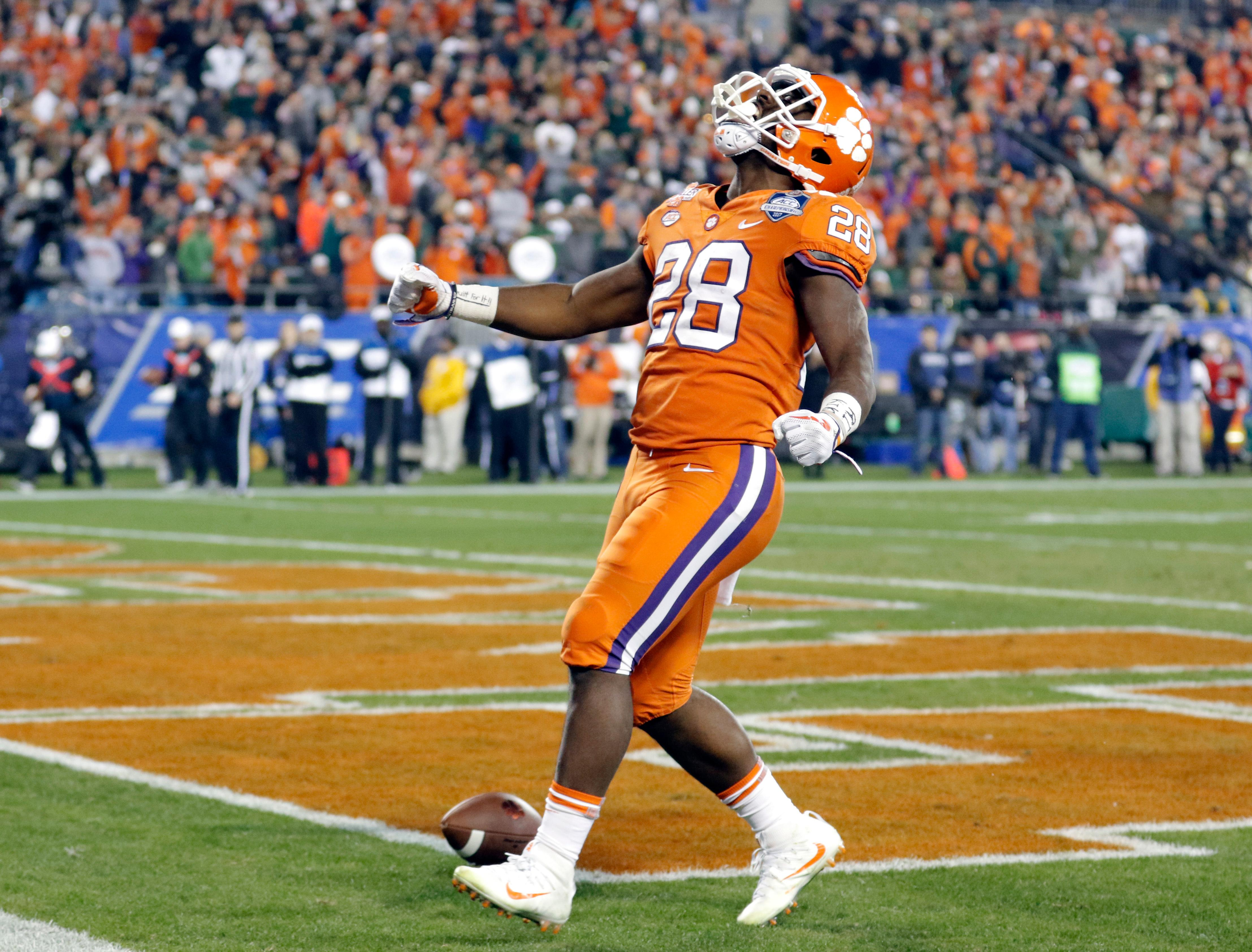 Clemson's Tavien Feaster (28) celebrates his touchdown run against Miami during the second half of the Atlantic Coast Conference championship NCAA college football game in Charlotte, N.C., Saturday, Dec. 2, 2017. (AP Photo/Bob Leverone)