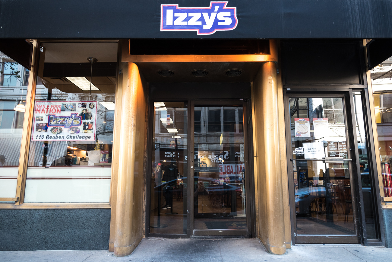 Izzy's, the popular Cincinnati eatery, is famous for its corned beef reuben sandwich. Izzy Kadetz's parents opened the first kosher delicatessen west of the Alleghenies in the early 1900s, and by the 1960s, Izzy had moved it to Elm Street. The restaurant became synonymous with tasty sandwiches, kosher pickles, and potato pancakes in the intervening years. The Main Street location (pictured) opened in the 1980s. / Image: Phil Armstrong, Cincinnati Refined // Published: 4.6.17