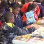 Unity Elementary school kids receive gifts before holiday season