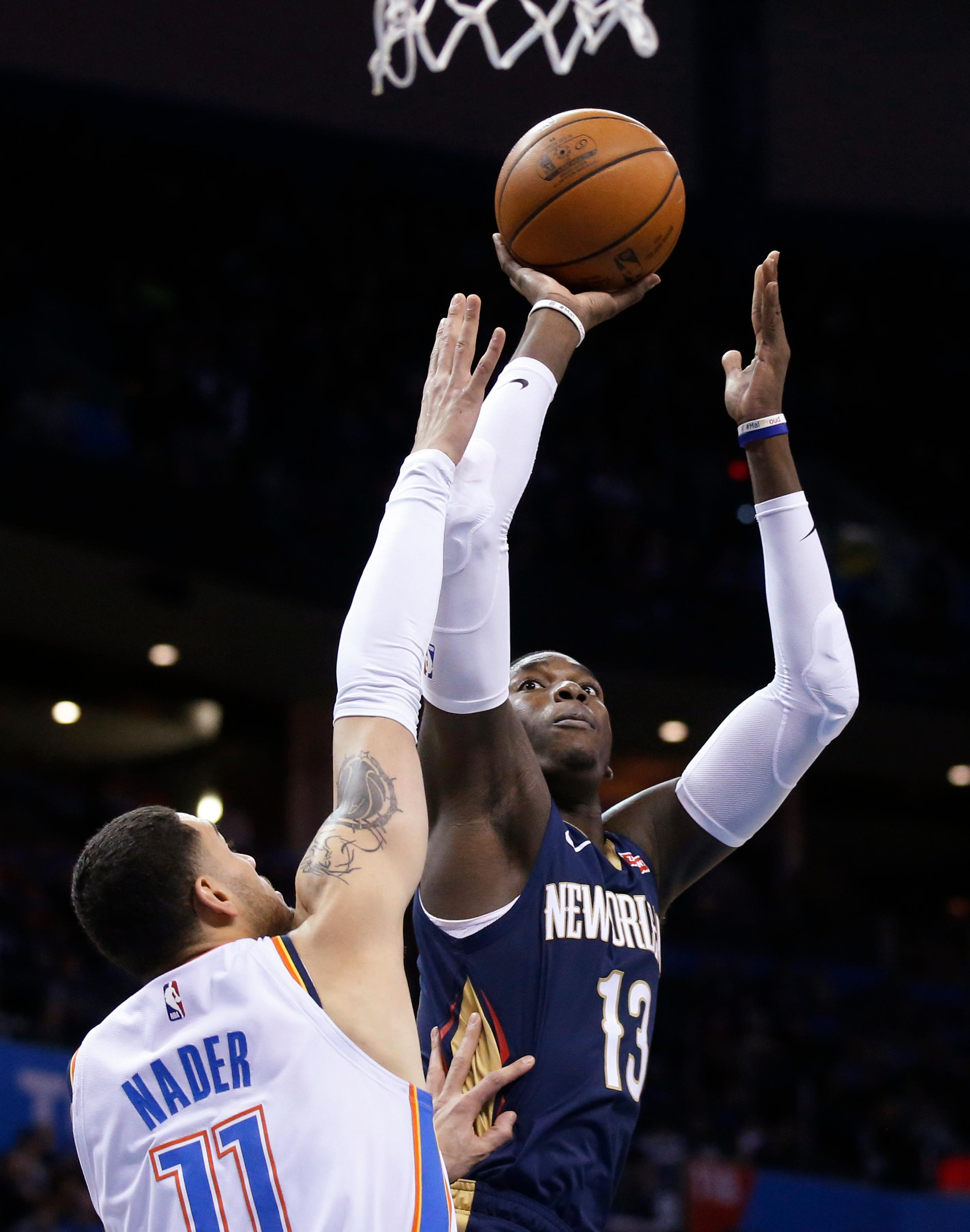 New Orleans Pelicans forward Cheick Diallo (13) shoots over Oklahoma City Thunder forward Abdel Nader (11) during the first half of an NBA basketball game in Oklahoma City, Thursday, Jan. 24, 2019. (AP Photo/Sue Ogrocki)