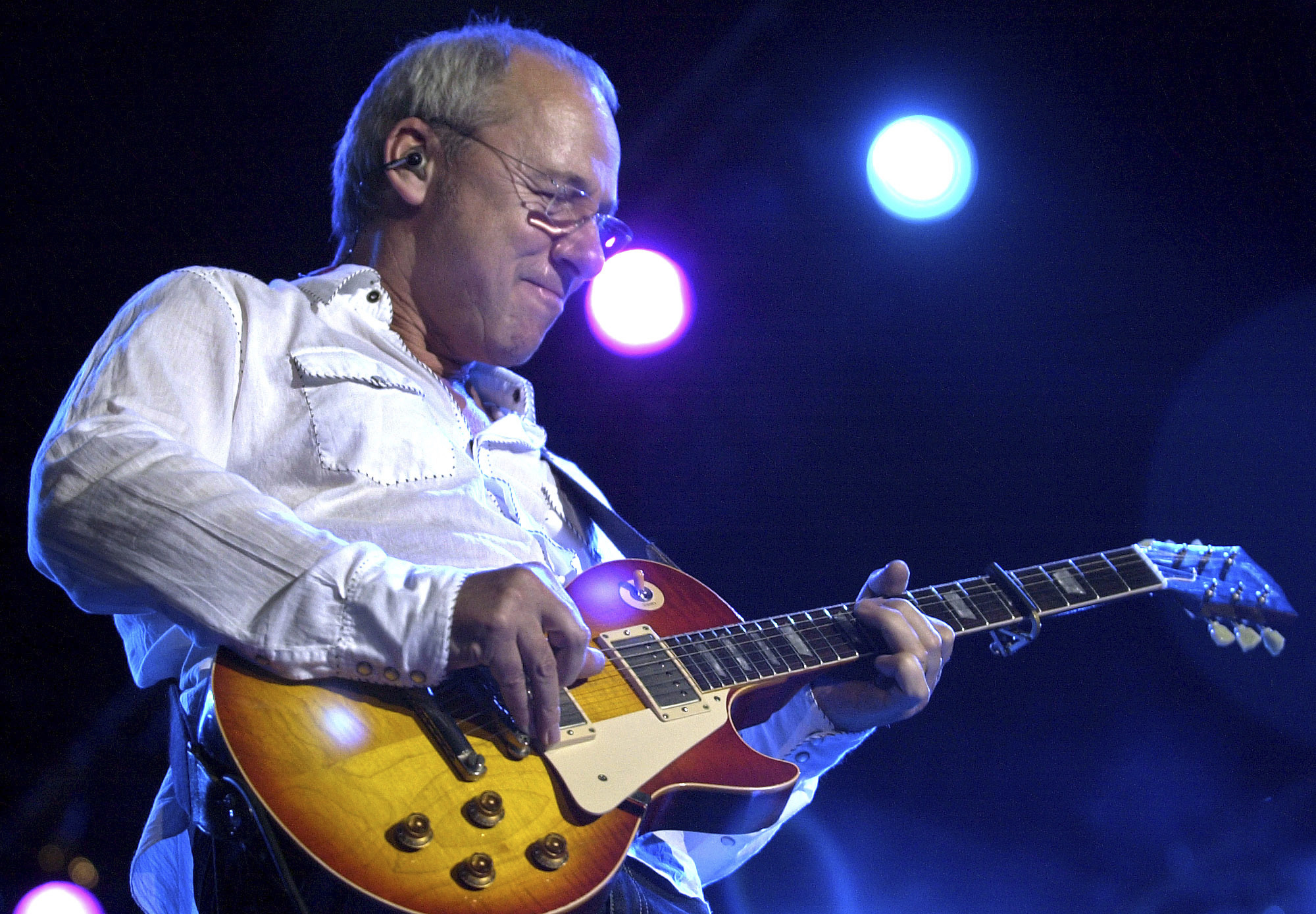 FILE - In this March 5, 2005 file photo, Dire Straits lead guitarist Mark Knopfler performs at a concert in Bombay, India. English rockers Dire Straits will be inducted into the Rock and Roll Hall of Fame on April 14, 2018 in Cleveland, Ohio.  (AP Photo/Aijaz Rahi, File)