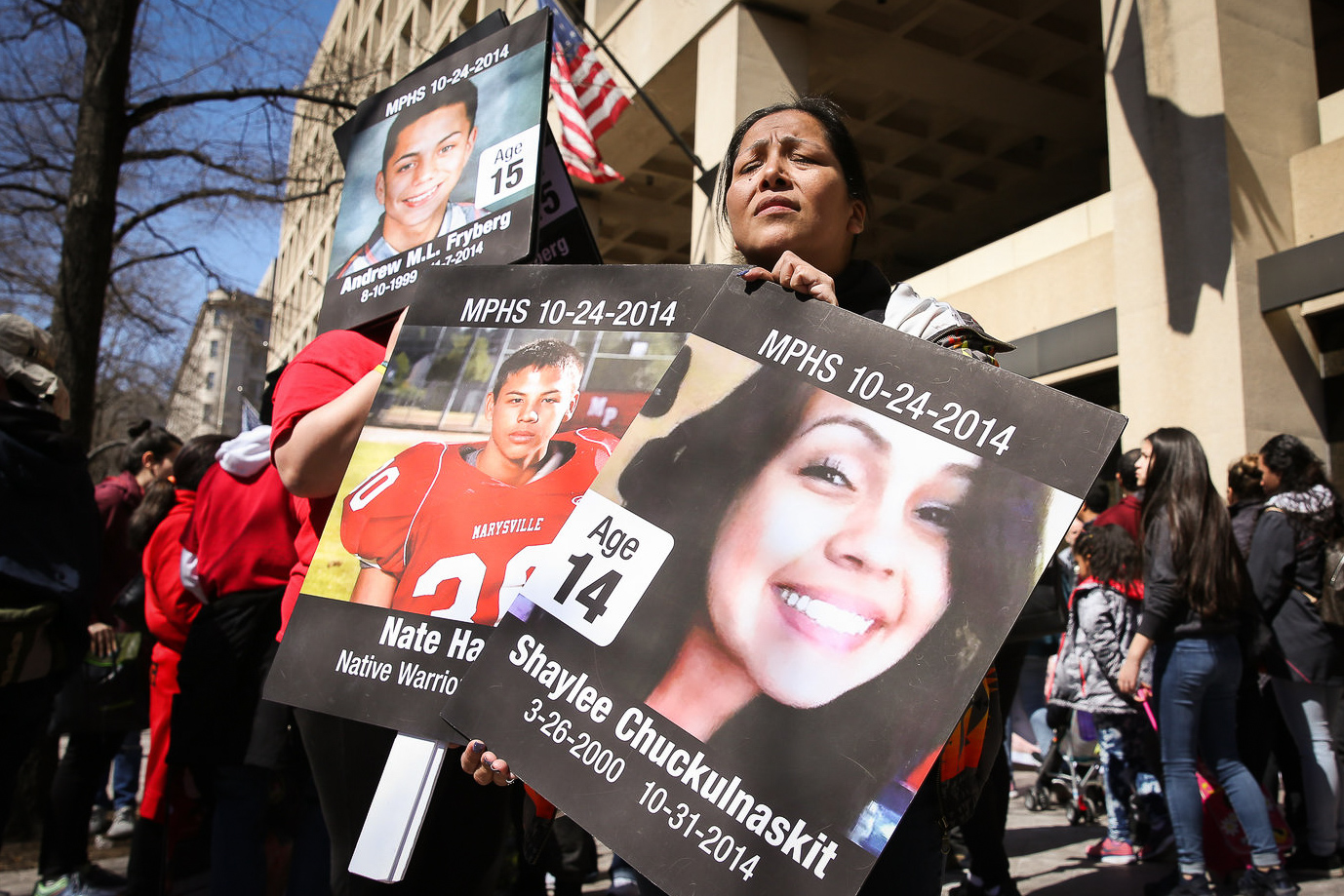 Members of the Tulalip tribe hold up memorials for students killed at the Marysville Pilchuck High School shooting in 2014 at the March for Our Lives in Washington, D.C. (Amanda Andrade-Rhoades/DC Refined)