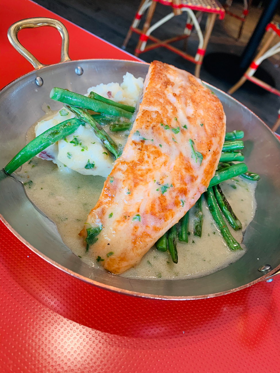 Salmon with citrus beurre blanc, capers, mashed redskins, and haricots verts / Image courtesy of The Mercer OTR // Published: 5.14.20