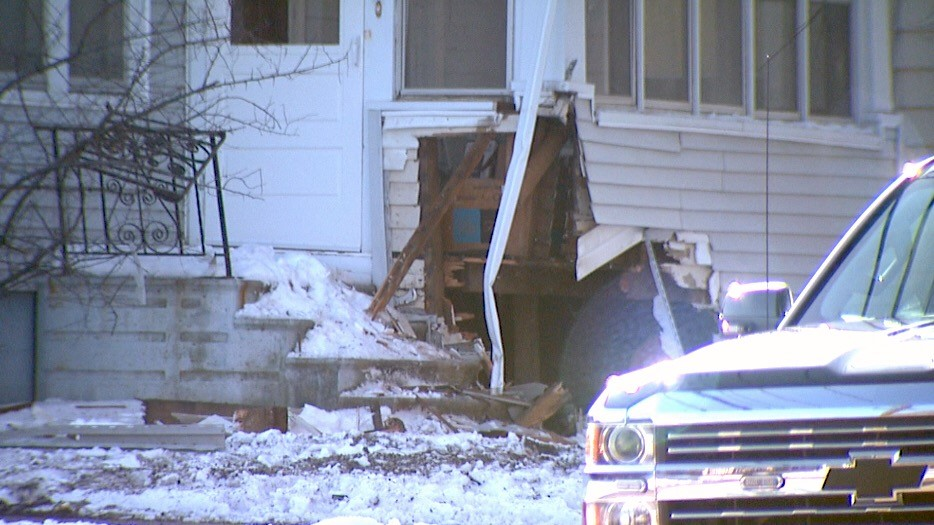 A Green Bay home damaged after a car crashed into it on Saturday, April 7, 2018. (WLUK/Jessie Basinski)