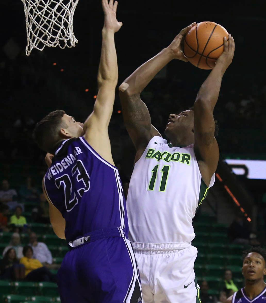 Baylor forward Mark Vital (11) rebounds the ball against Central Arkansas forward Aaron Weidenaar (23) in the second half of a NCAA college basketball game, Friday, Nov. 10, 2017, in Waco, Tx. Baylor won 107-66. (AP Photo/Jerry Larson)