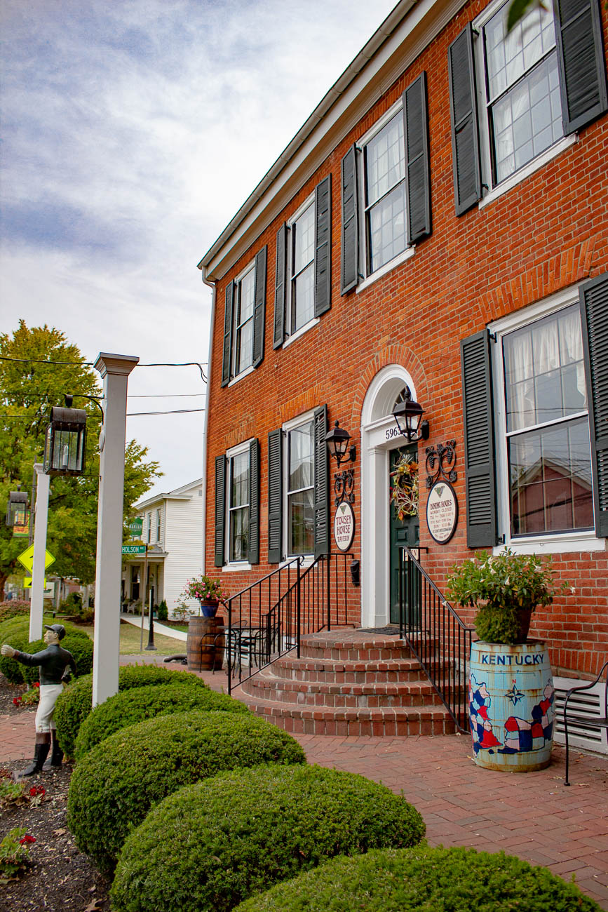 The land was bought in 1817 by Attorney Erastus Tousey for a whopping $25. The home was built in 1822 where he lived with Catherine, his wife, and their six kids until he died in 1863. The home has been converted into a hotel, boarding house, as well as a handful of restaurants and shops at various points in time. In 1987, Former Judge Bruce Ferguson and Elizabeth, his wife, restored the home to its former glory after it had been vacant for a decade. / Image: Katie Robinson, Cincinnati Refined // Published: 11.11.19