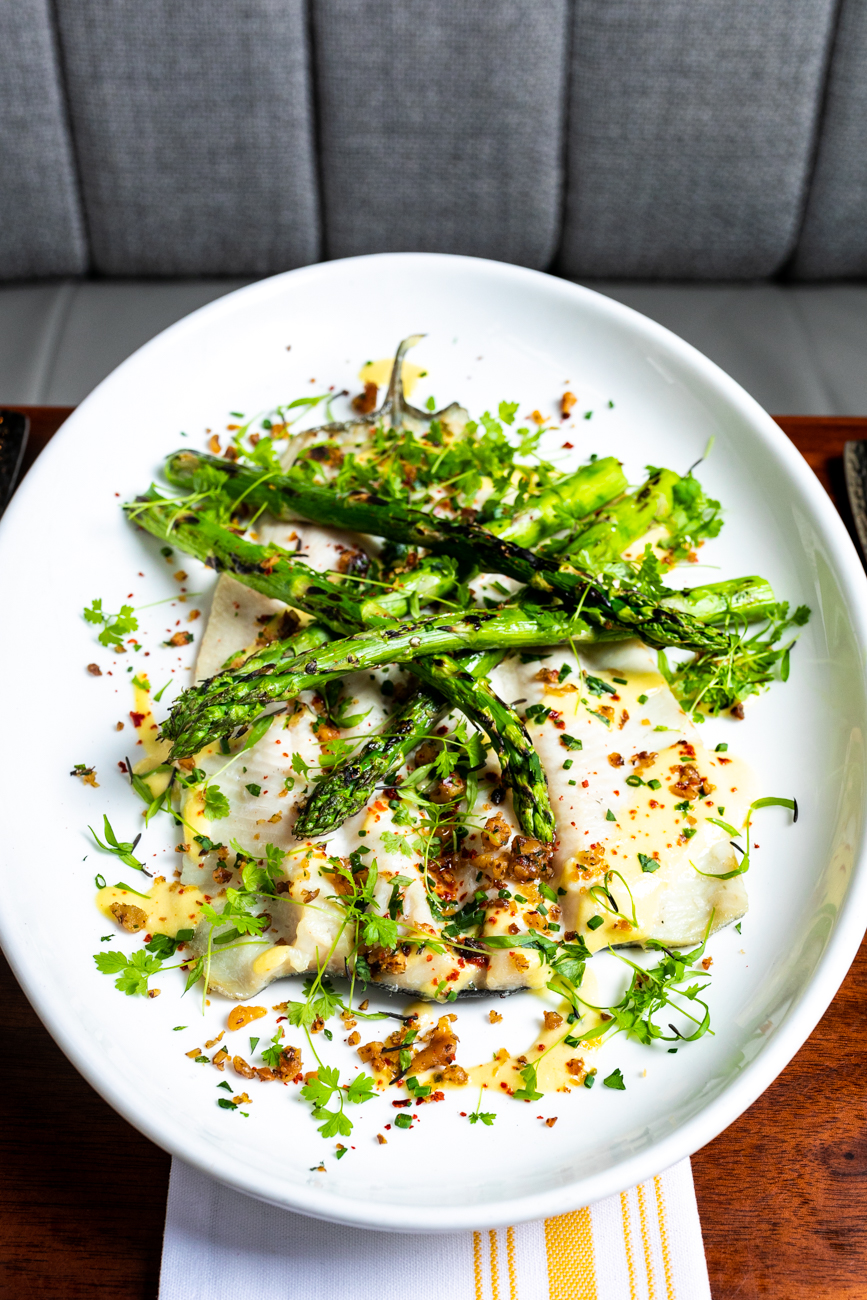 <p>Rainbow Trout: grilled asparagus, onion soubise, and walnut gremolata / Image: Amy Elisabeth Spasoff // Published: 5.3.19</p>