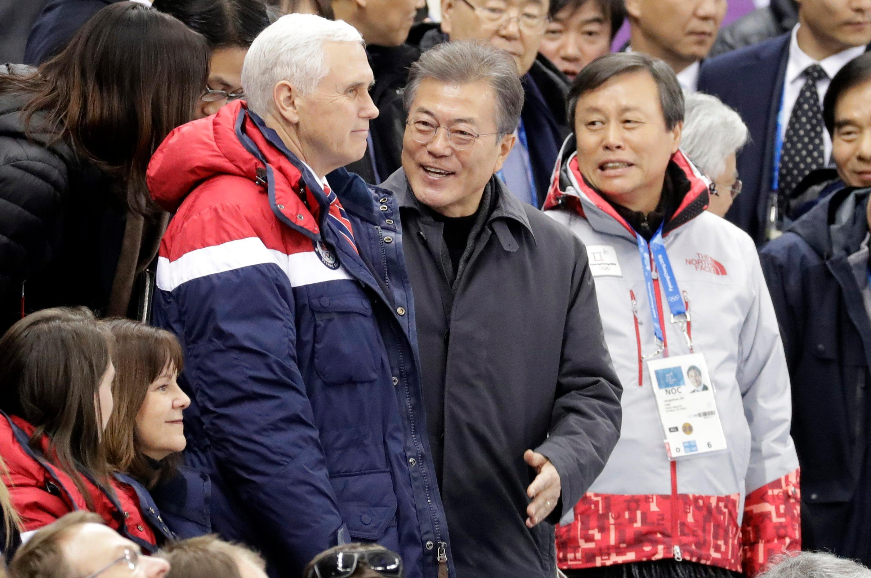 United States' Vice President Mike Pence, centre left and South Korean President Moon Jae-in attend the ladies' 500 meters short-track speedskating in the Gangneung Ice Arena at the 2018 Winter Olympics in Gangneung, South Korea, Saturday, Feb. 10, 2018. (AP Photo/Bernat Armangue)
