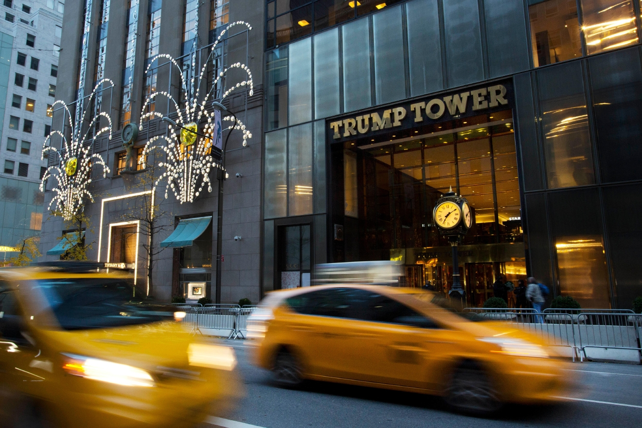 Traffic passes Trump Tower, Monday, Nov. 21, 2016, in New York. (AP Photo/Mark Lennihan)