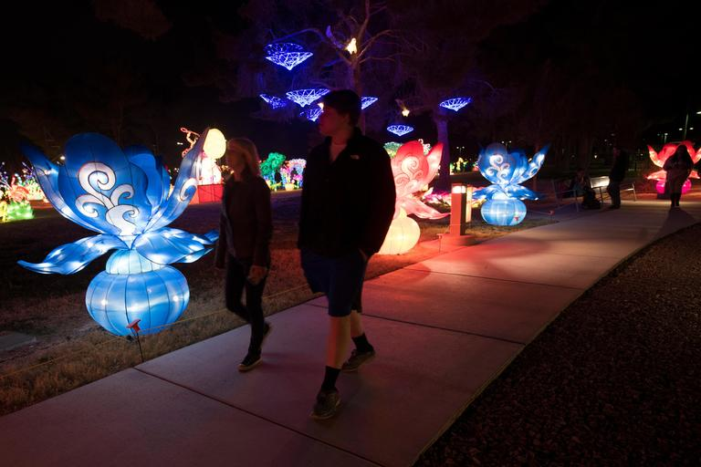 A couple walks past illuminated flowers on the opening night of the China Lights lantern festival Friday, January 19, 2018, at Craig Ranch Regional Park in North Las Vegas. The festival, which features nearly 50 silk and LED light displays comprised of over 1000 elements, runs through February 25th. CREDIT: Sam Morris/Las Vegas News Bureau