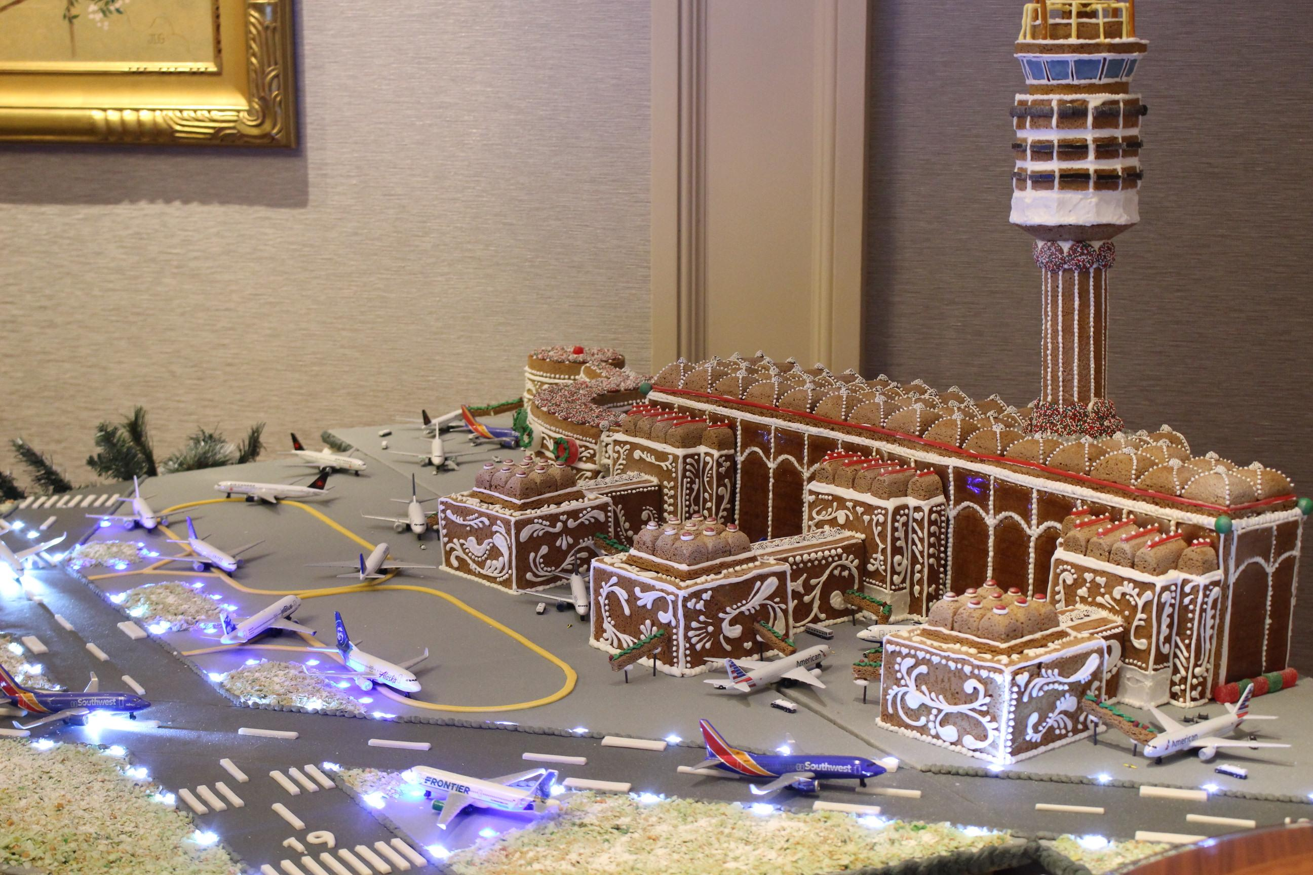Taking over 350 hours, this display weighs nearly 400 lbs. and contains over 100 LED lights, 30 ft. of electrical wire, 306 pieces of gingerbread and 30 lbs. of fondant (for the airport's three runways). It even includes a real-time live audio feed from the control tower at DCA. (Image: Courtesy The Willard InterContinental)