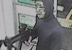 Masked robber with machine gun.PNG
