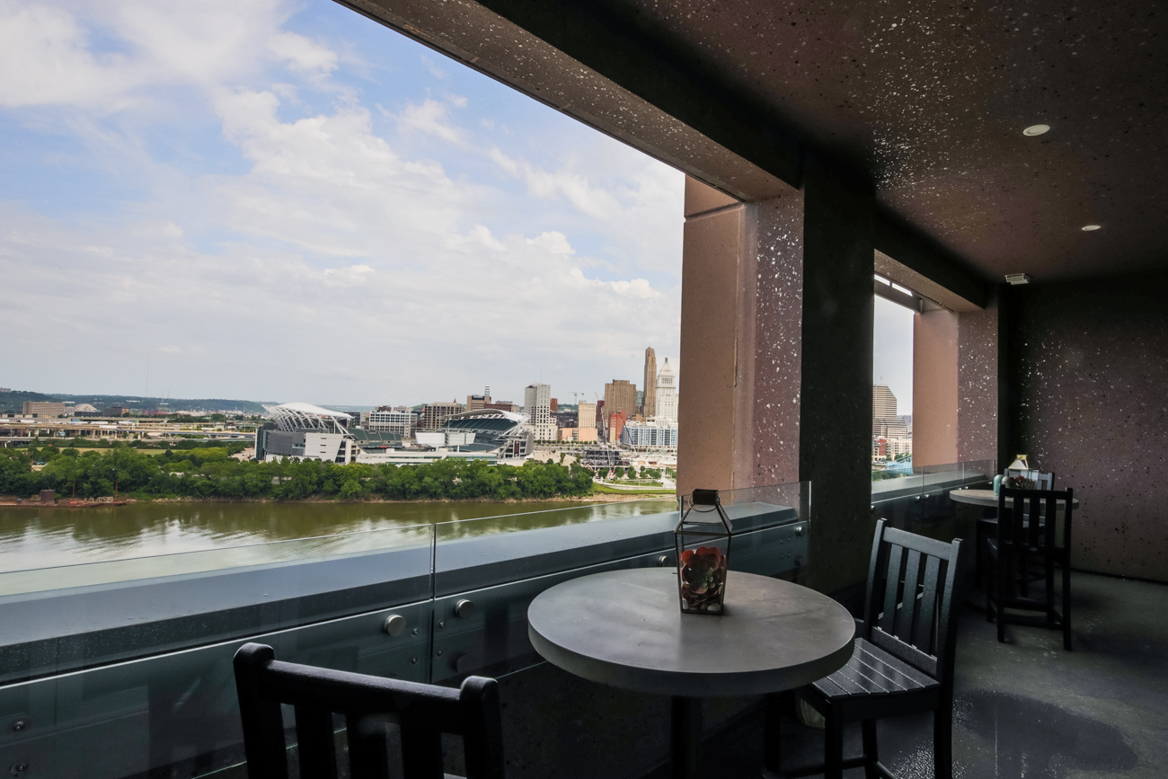 It features multiple river-view terraces—one of which has an outdoor kitchen and fire pit. Madison Place also offers direct access to the Marriot Hotel, restaurant, and bar, and it's in walking distance of plenty dining and shopping destinations in Covington. / Image: Catherine Viox // Published: 7.7.20