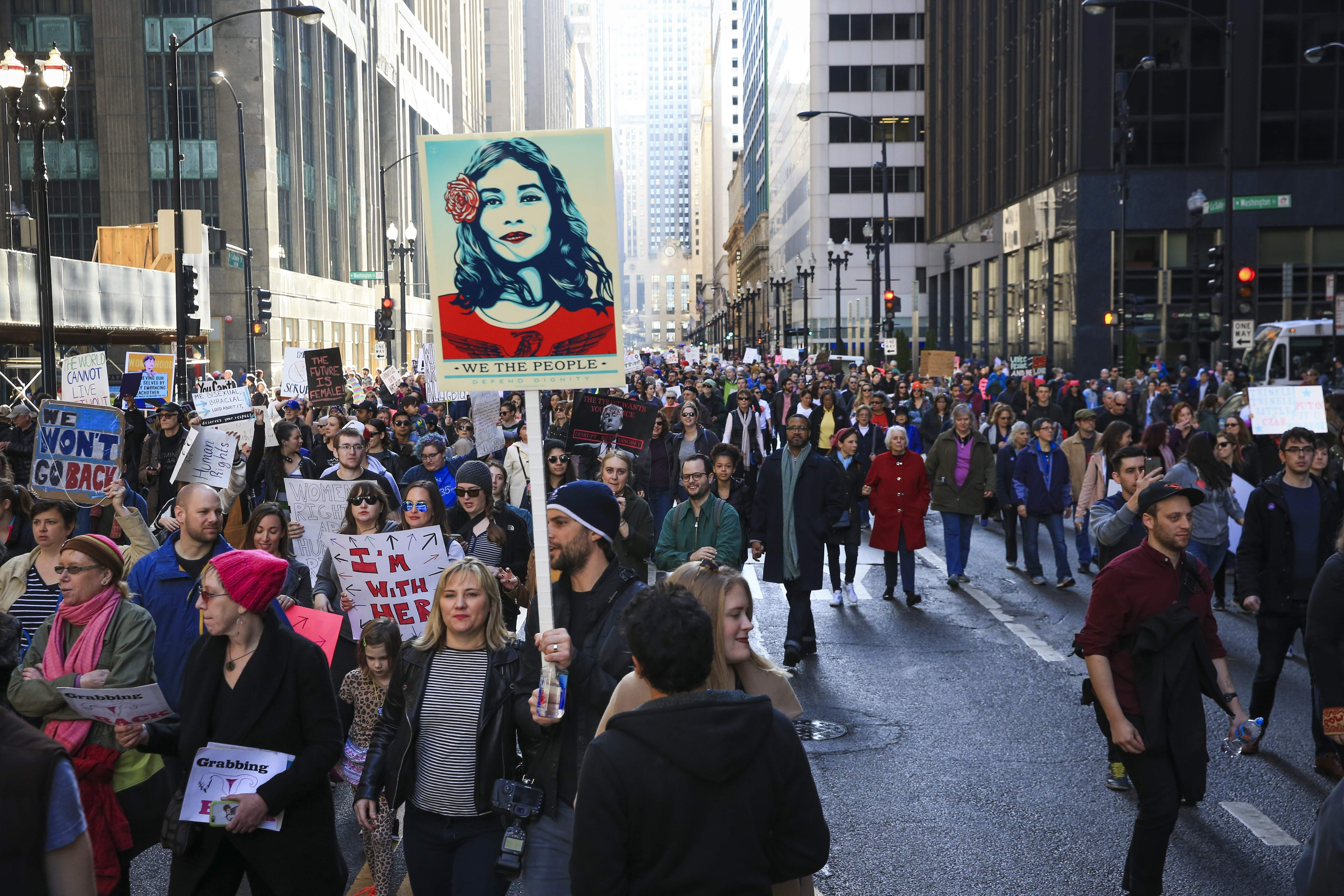 Protesters walk along North LaSalle Street during the Women's March on Chicago the day after President Donald Trump's inauguration Saturday, Jan. 21, 2017 in Chicago. THE ASSOCIATED PRESS
