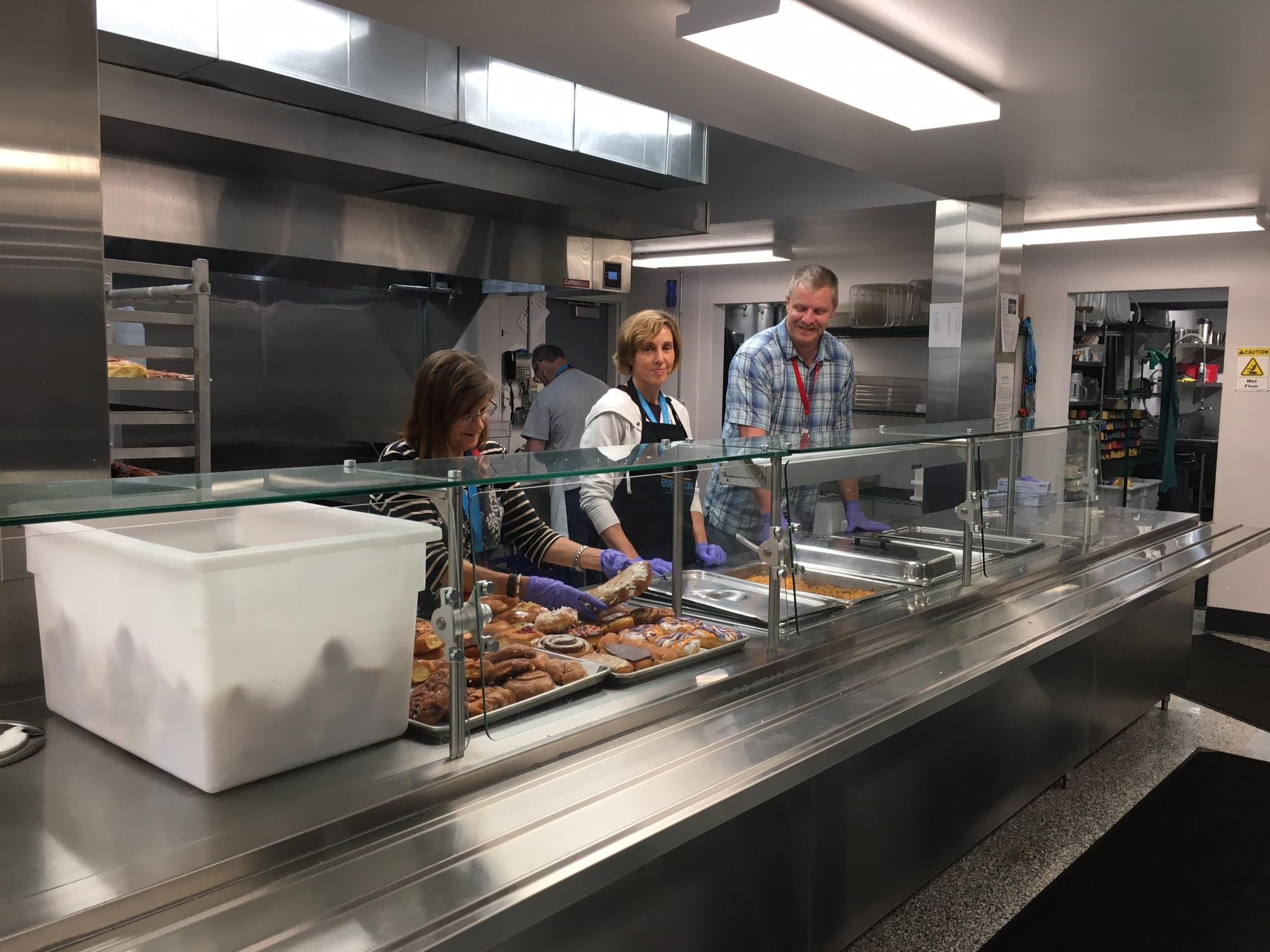 The new Eugene Mission kitchen is busier than ever. The kitchen was destroyed on June 15, 2016. The new kitchen opened December 2016. (SBG photo)