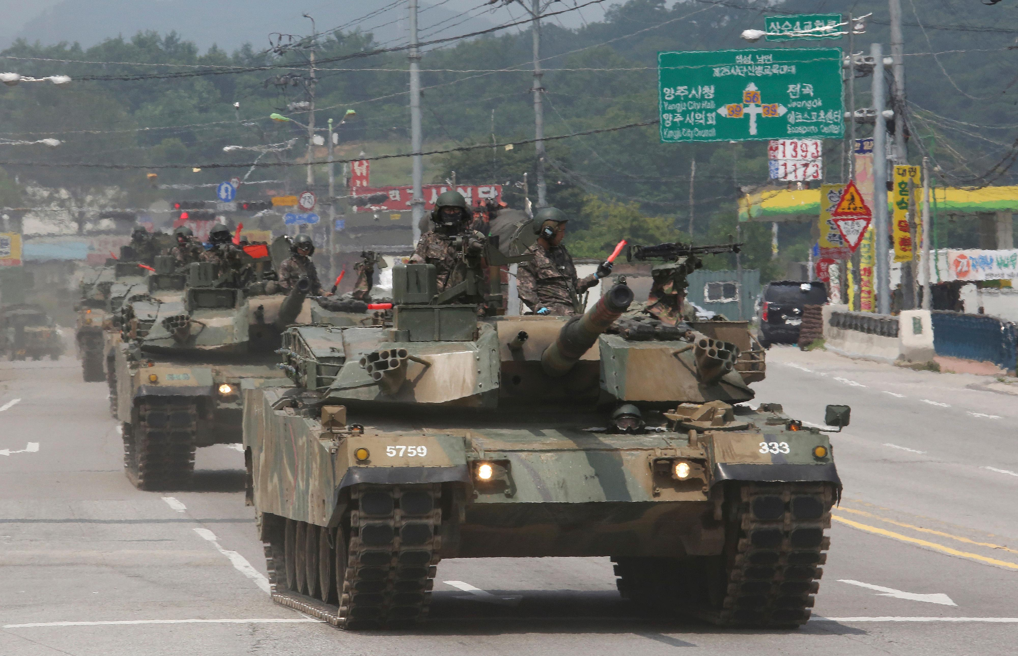 South Korean army K-1 tanks move during the annual exercise in Paju, South Korea, near the border with North Korea,  Wednesday, July 5, 2017. (AP Photo/Ahn Young-joon)
